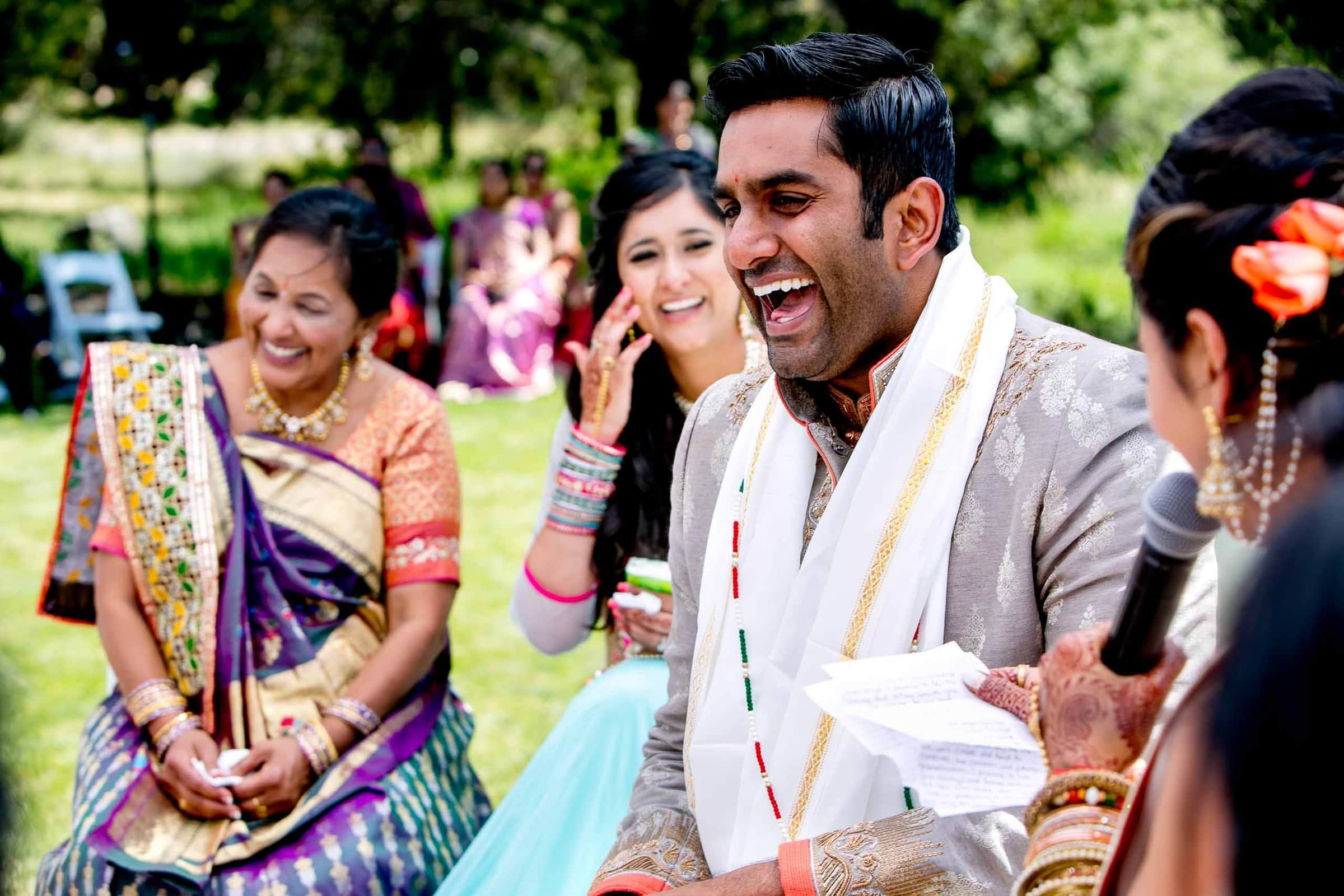 Happy photo of groom during an Indian Sunriver Resort wedding in Bend Oregon in Central Oregon.