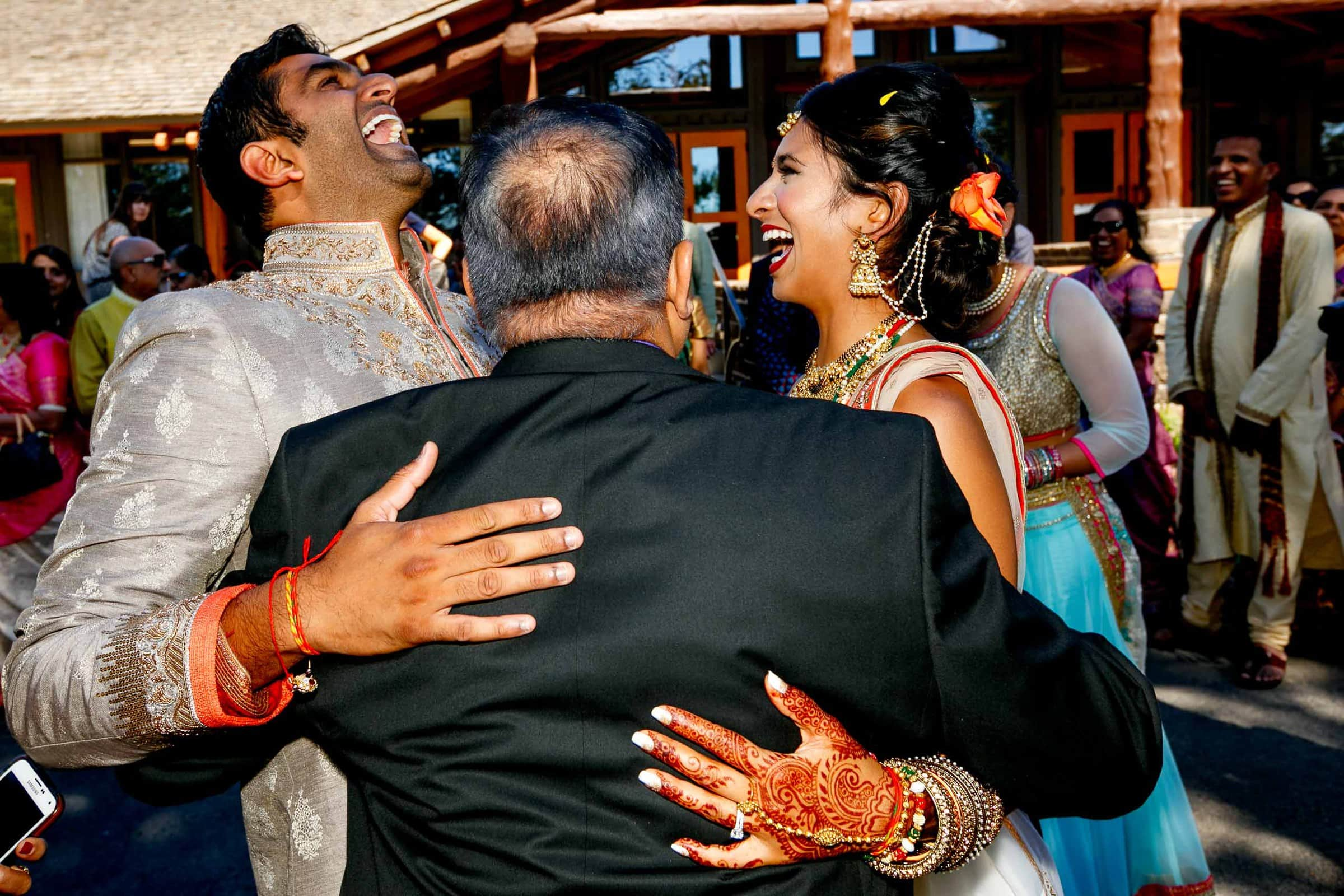 Happy photo of bride and groom exiting during an Indian Sunriver Resort wedding in Bend Oregon in Central Oregon.