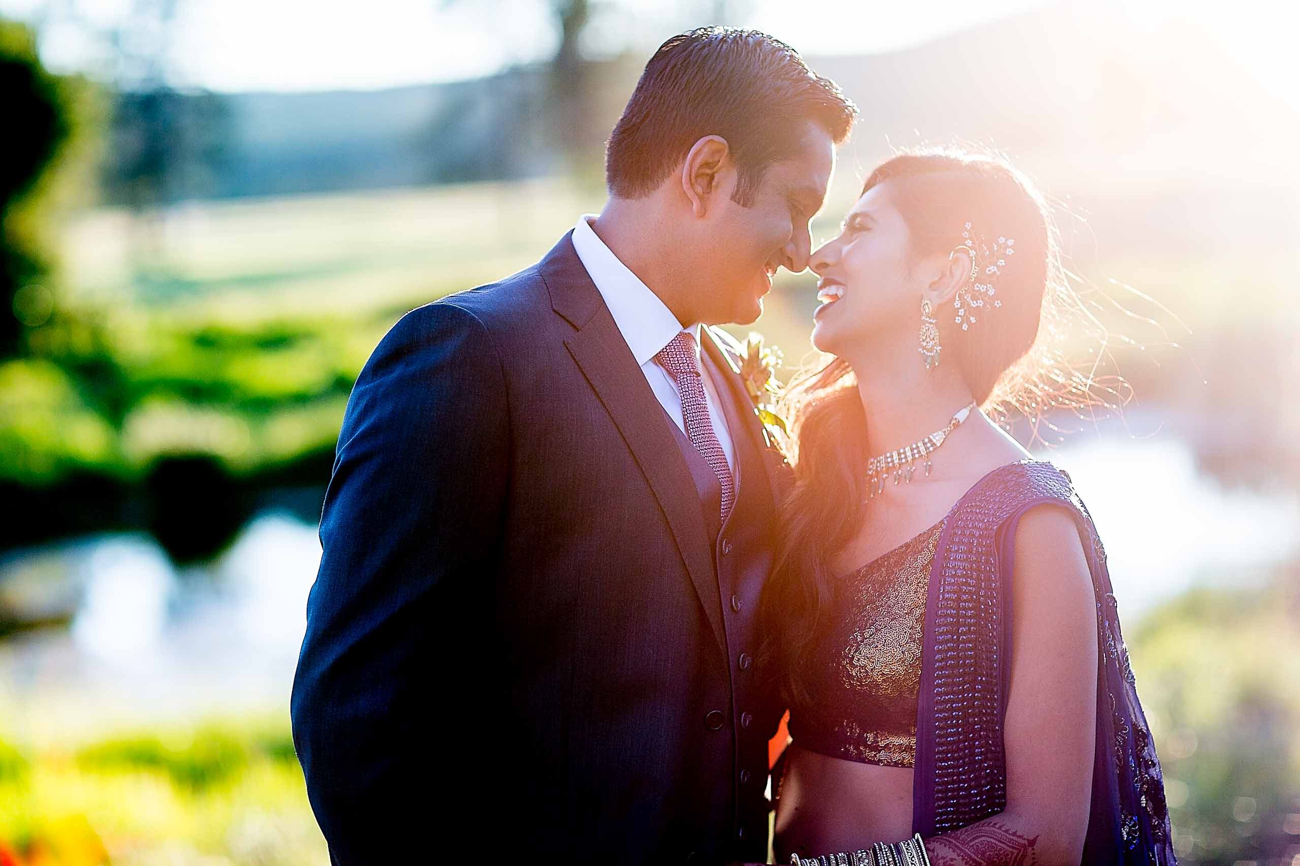 Golden sun photo of happy bride and groom during an Indian Sunriver Resort wedding in Bend Oregon in Central Oregon.