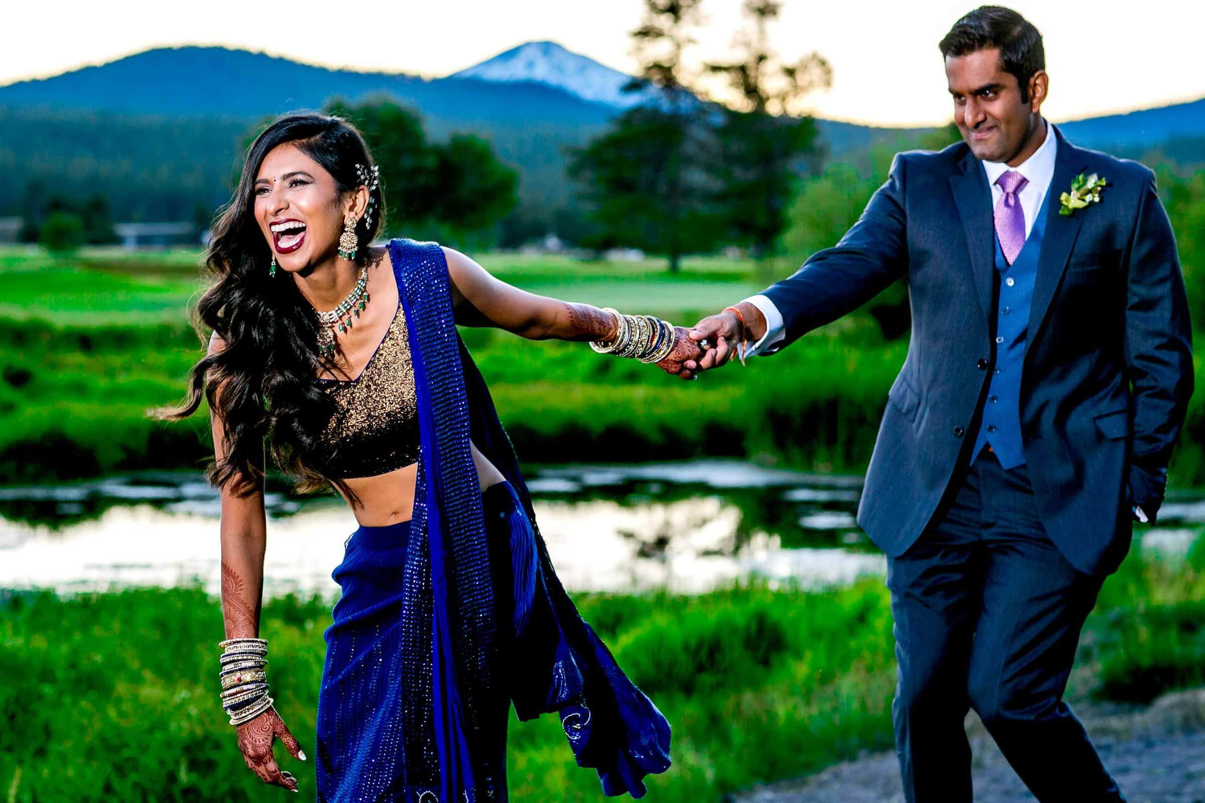 Fun photo of happy bride and groom during an Indian Sunriver Resort wedding in Bend Oregon in Central Oregon.