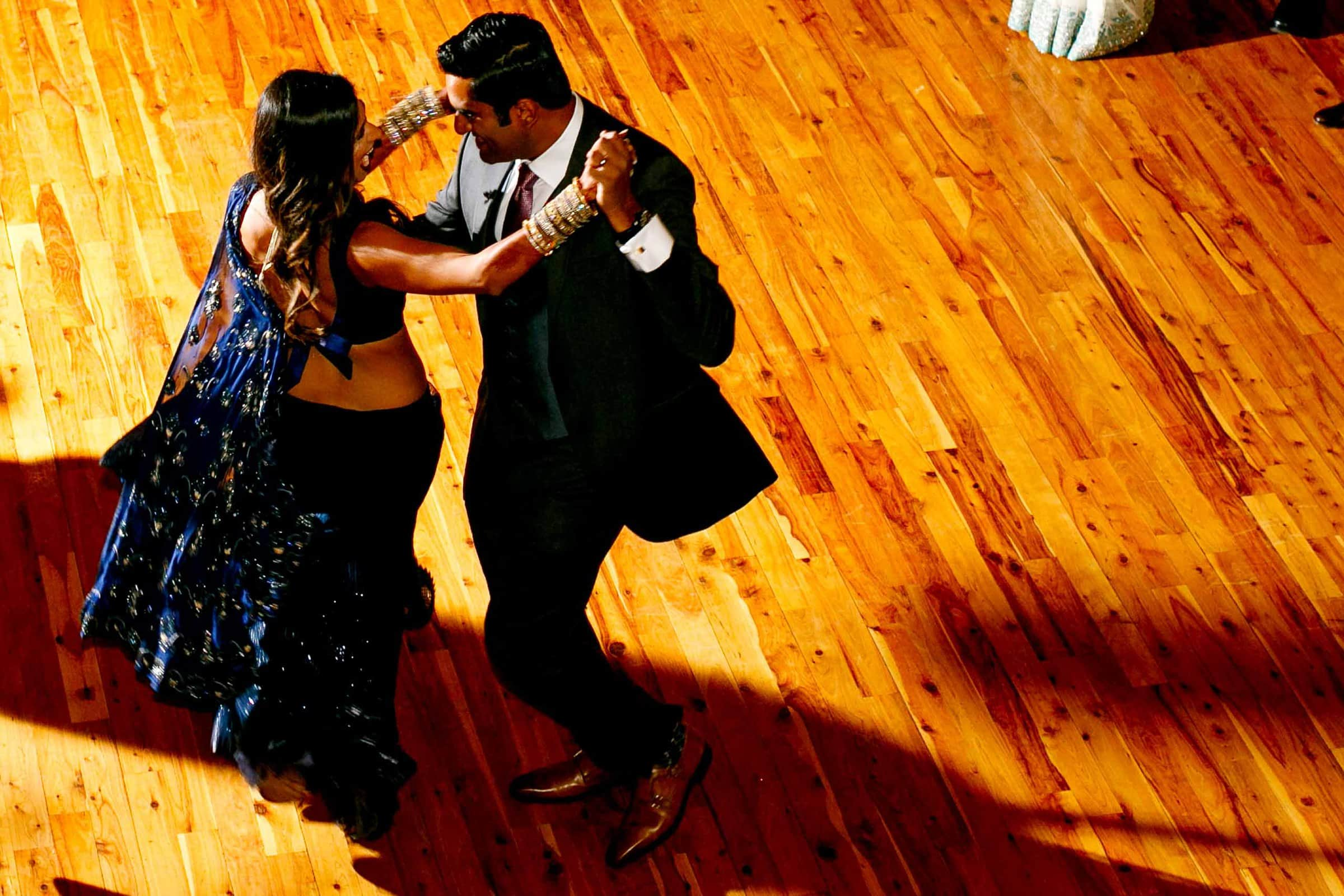 Fun photo of a bride entering her first dance with her groom during an Indian Sunriver Resort wedding in Bend Oregon in Central Oregon.