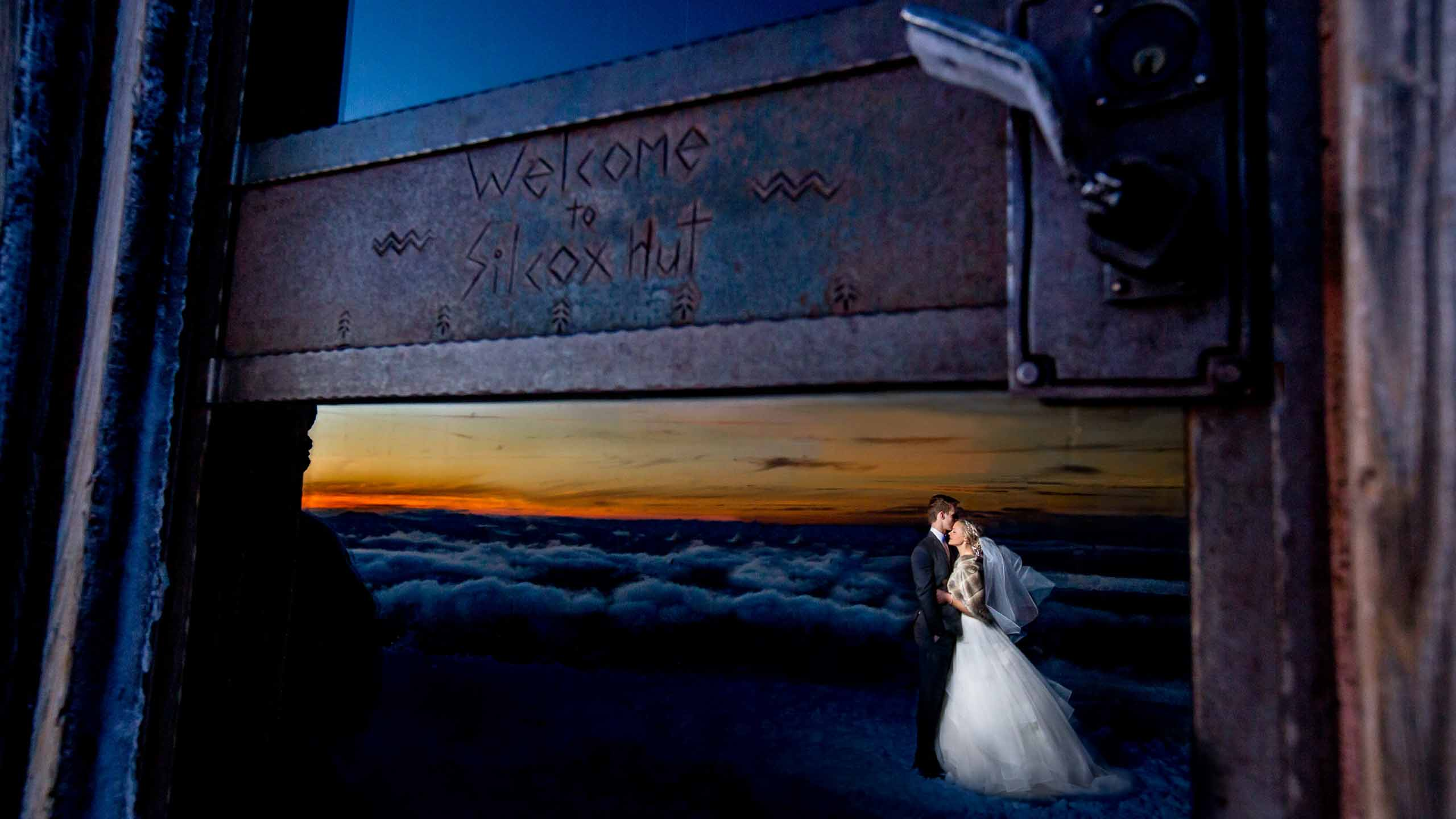Bride and Groom atop Mt Hood at Silcox Hut with epic view