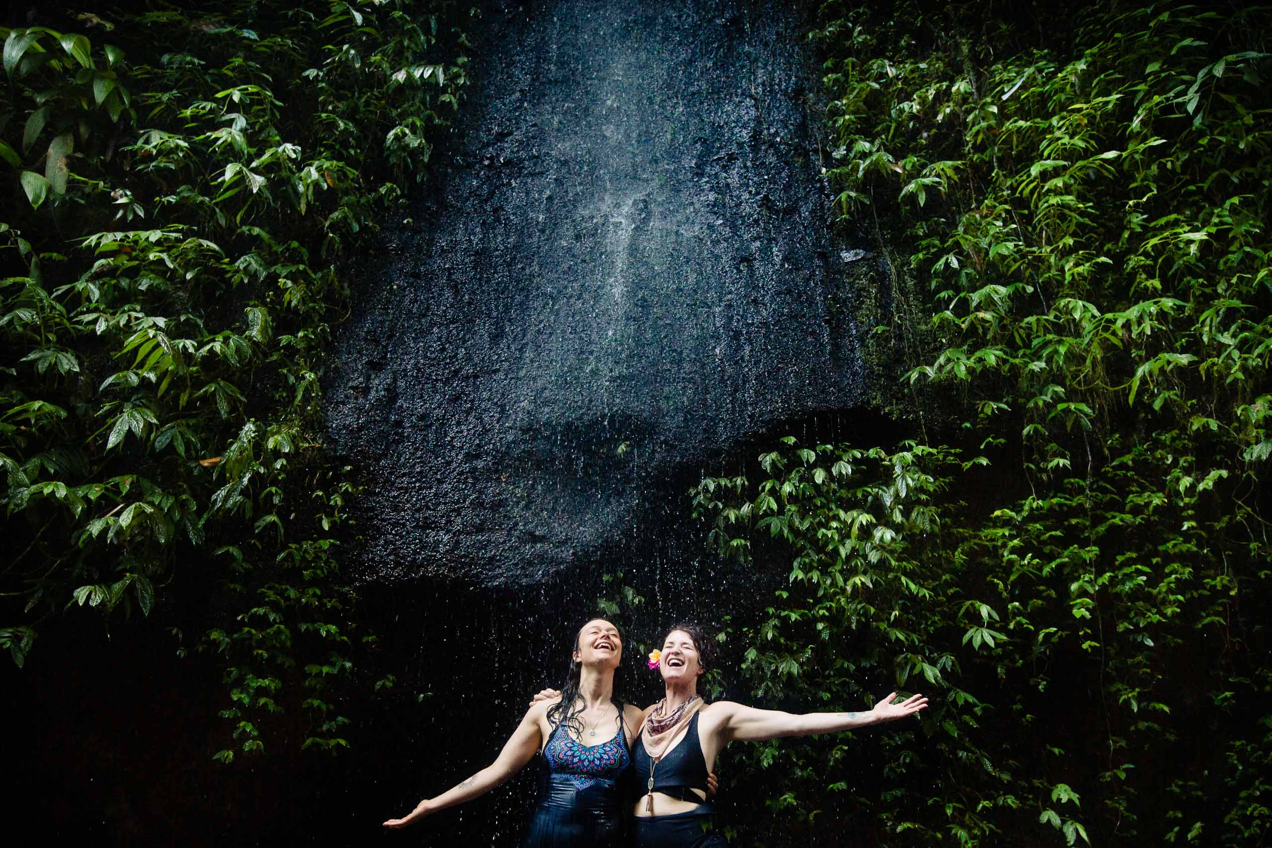TWO MANN studios reunion in Bali with 25 photographers. Photo of Tree WoodSmith and Abby Taylor in a waterfall in Bali. Photo by josandtree.
