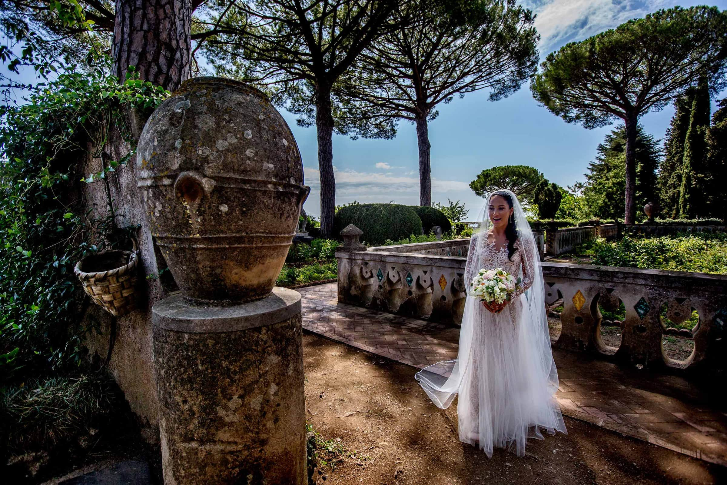 Stunning bride walking into her elopement ceremony during her Ravello elopement at Villa Cimbrone along the Amafi coast in Italy.