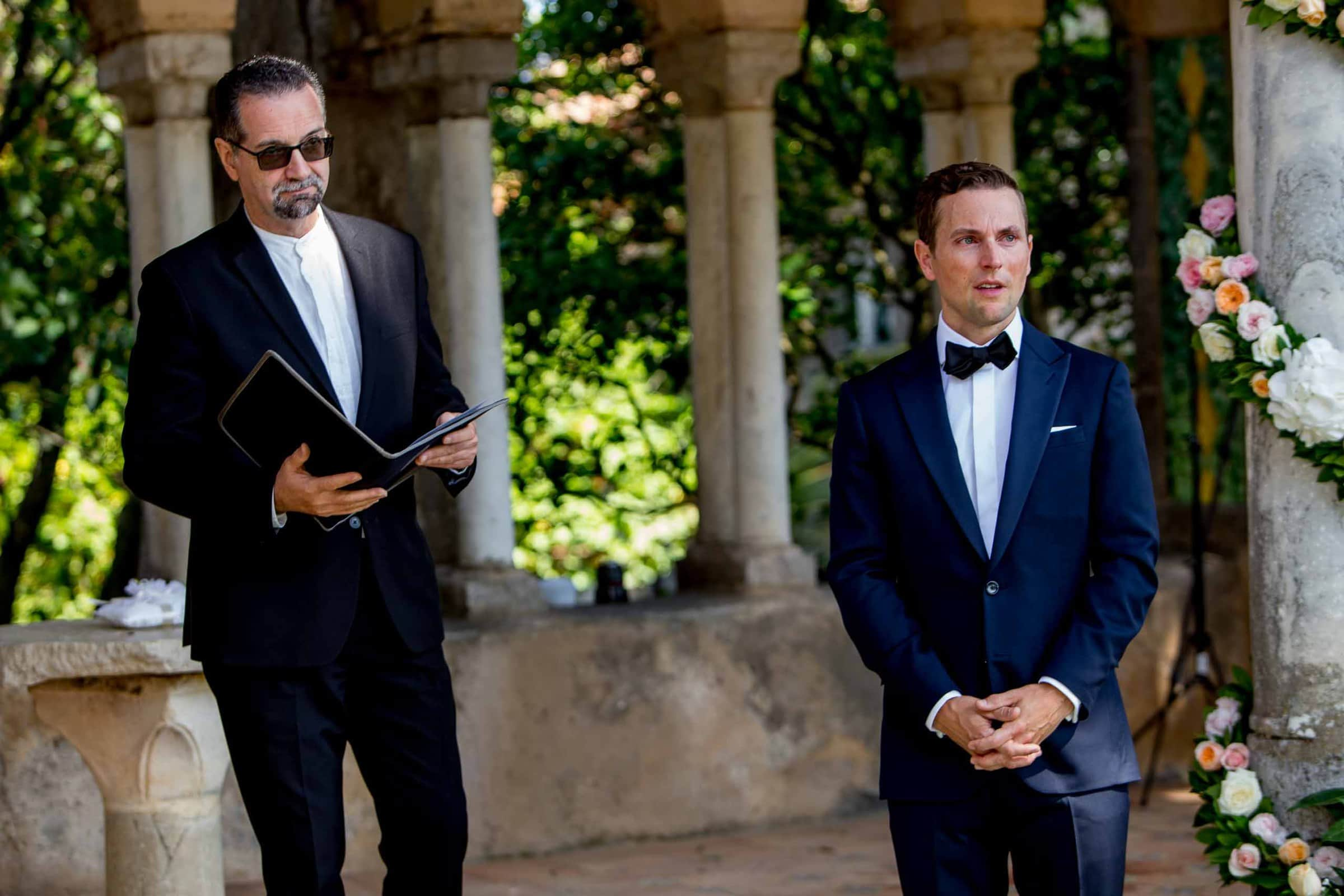 Emotional groom seeing his bride for the first time during their Ravello elopement ceremony at Villa Cimbrone in Amalfi, Italy