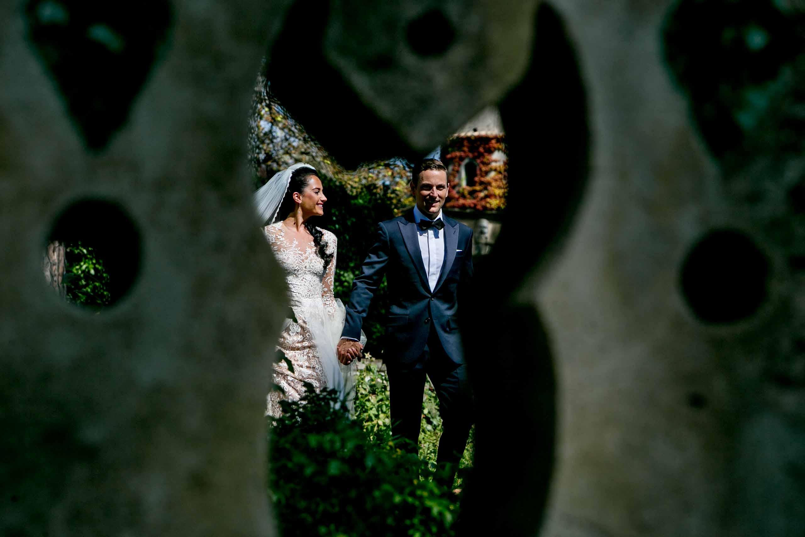 Bride and groom walking through Villa Cimbrone garden during their Ravello elopement in Amalfi, Italy