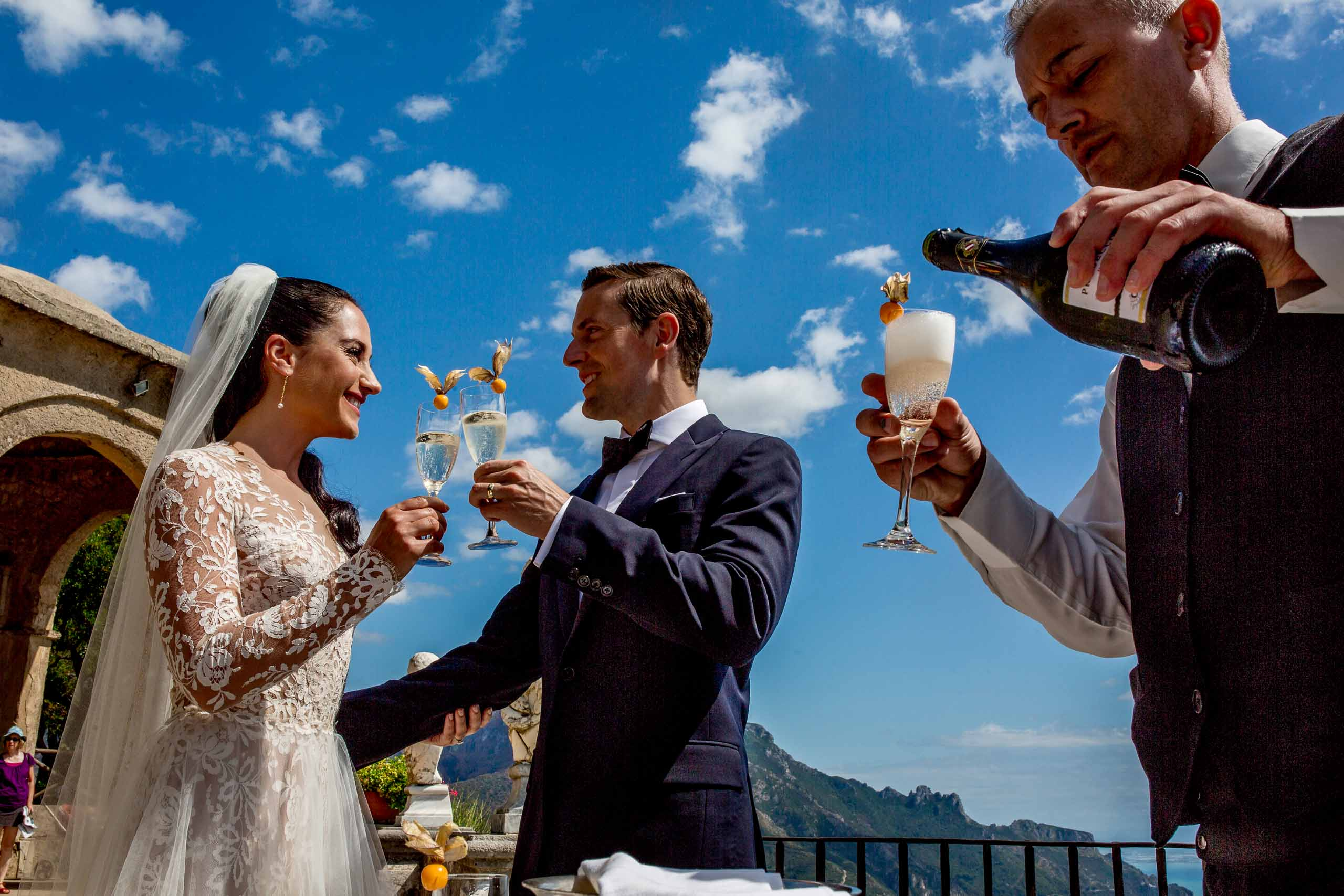 Bride and groom enjoying champagne on Villa Cimbrone terrace for their Ravello elopement in Amalfi, Italy