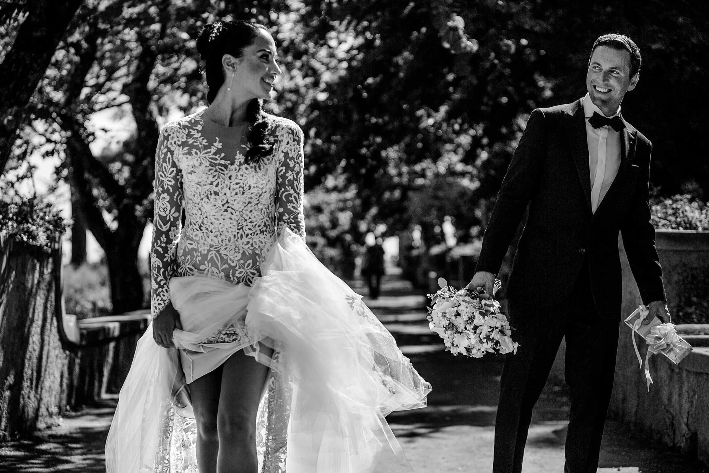 Gorgeous bride and groom walking through the Villa Cimbrone garden for their Ravello elopement in Amalfi, Italy