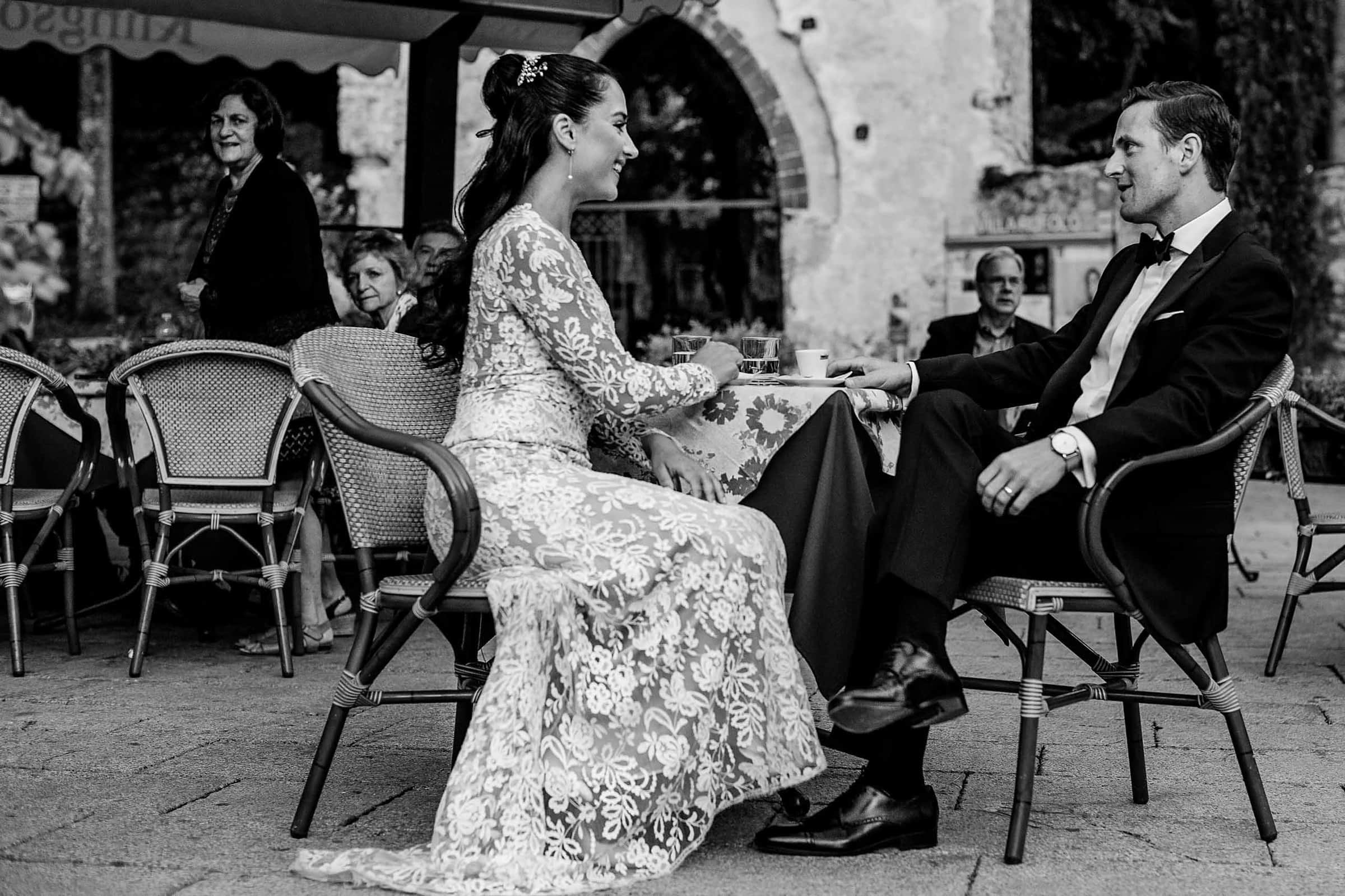 Bride and groom enjoying a coffee near Villa Cimbrone just after their ceremony for their Ravello wedding along the Amafi Coast in Italy