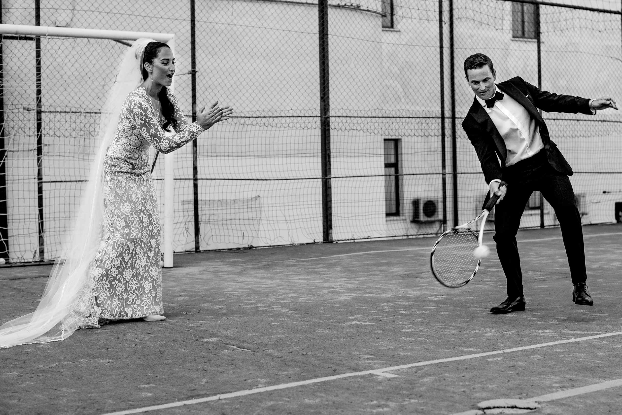 Fun bride and groom photo playing tennis at Villa Cimbrone for their Ravello wedding elopement along the Amafi coast in Italy.