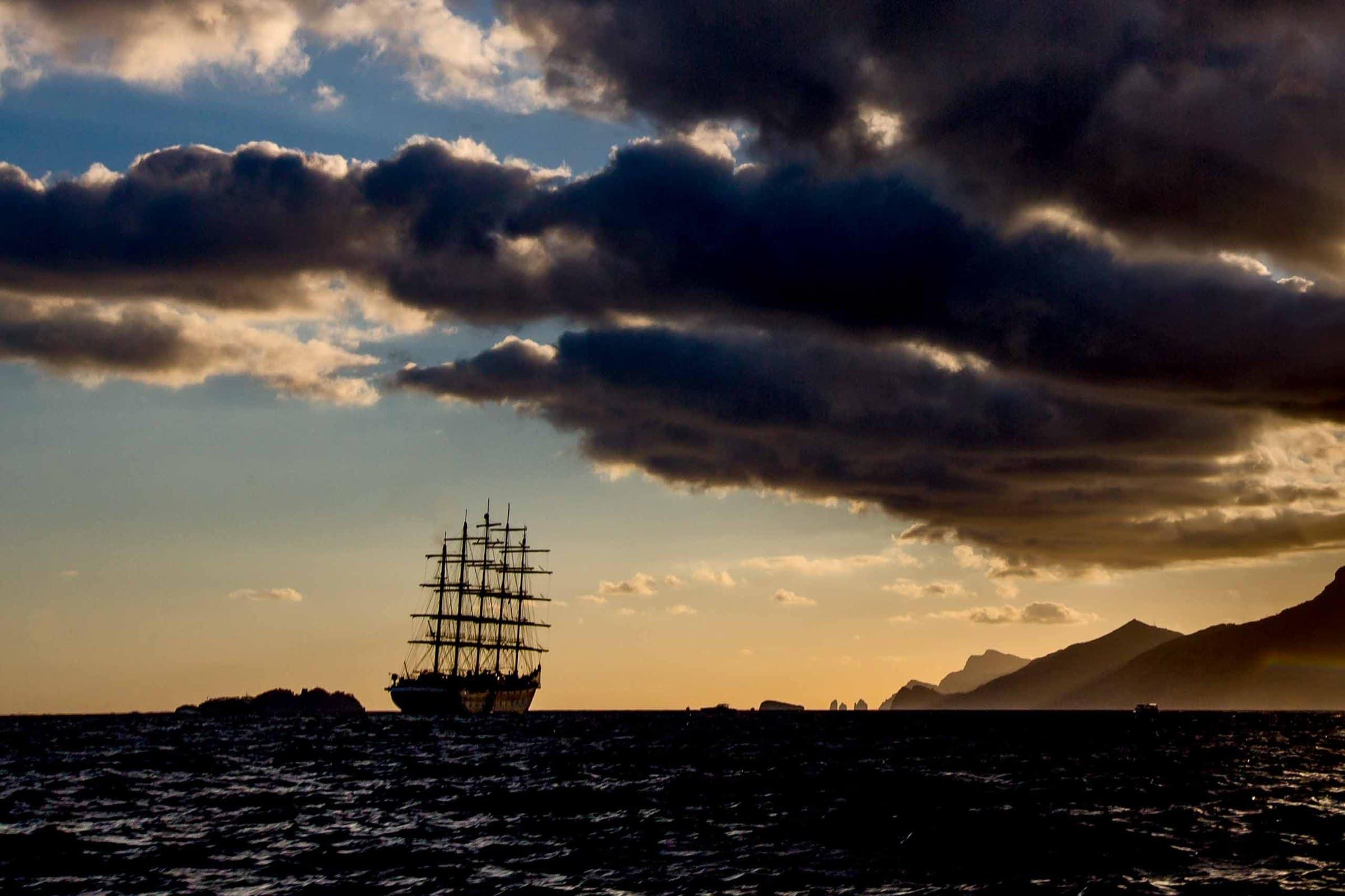 Enchanting photo of a ship at sea during a Ravello wedding at Villa Cimbrone along the Amafi Coast.