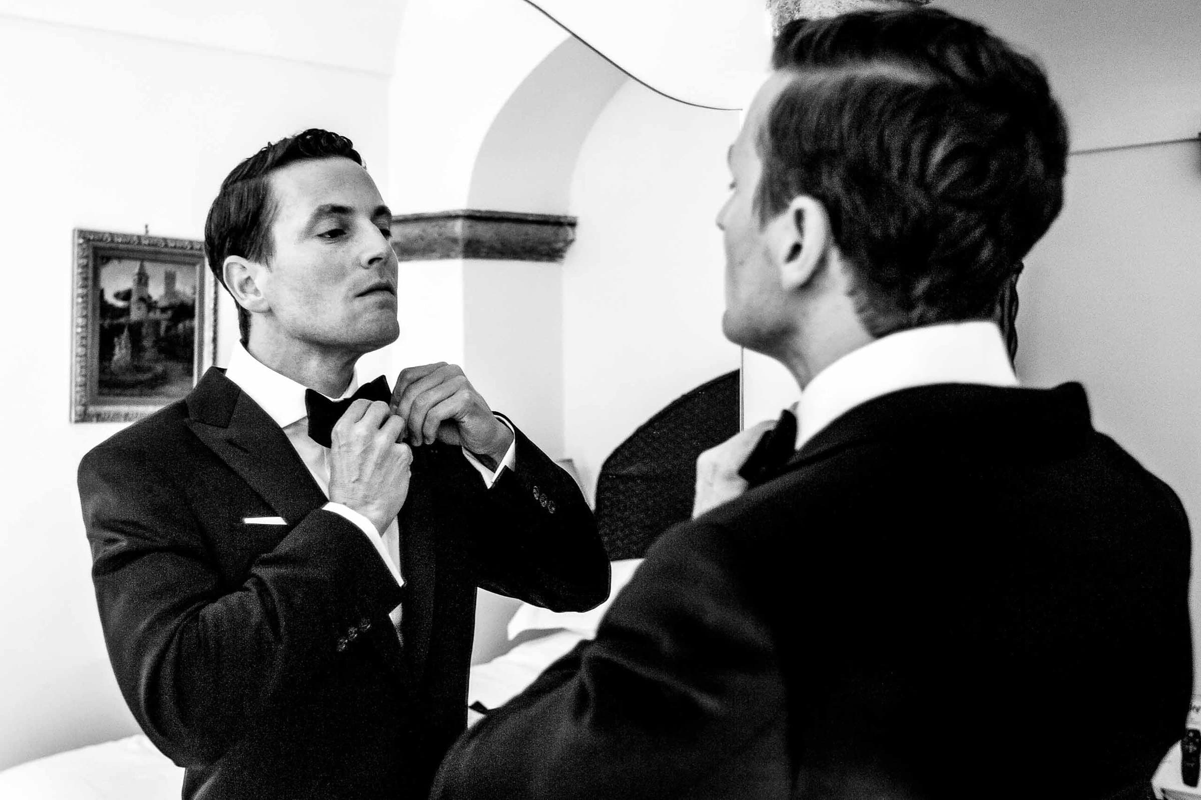 Groom getting ready for his Ravello elopement at Villa Cimbrone in Amalfi, Italy