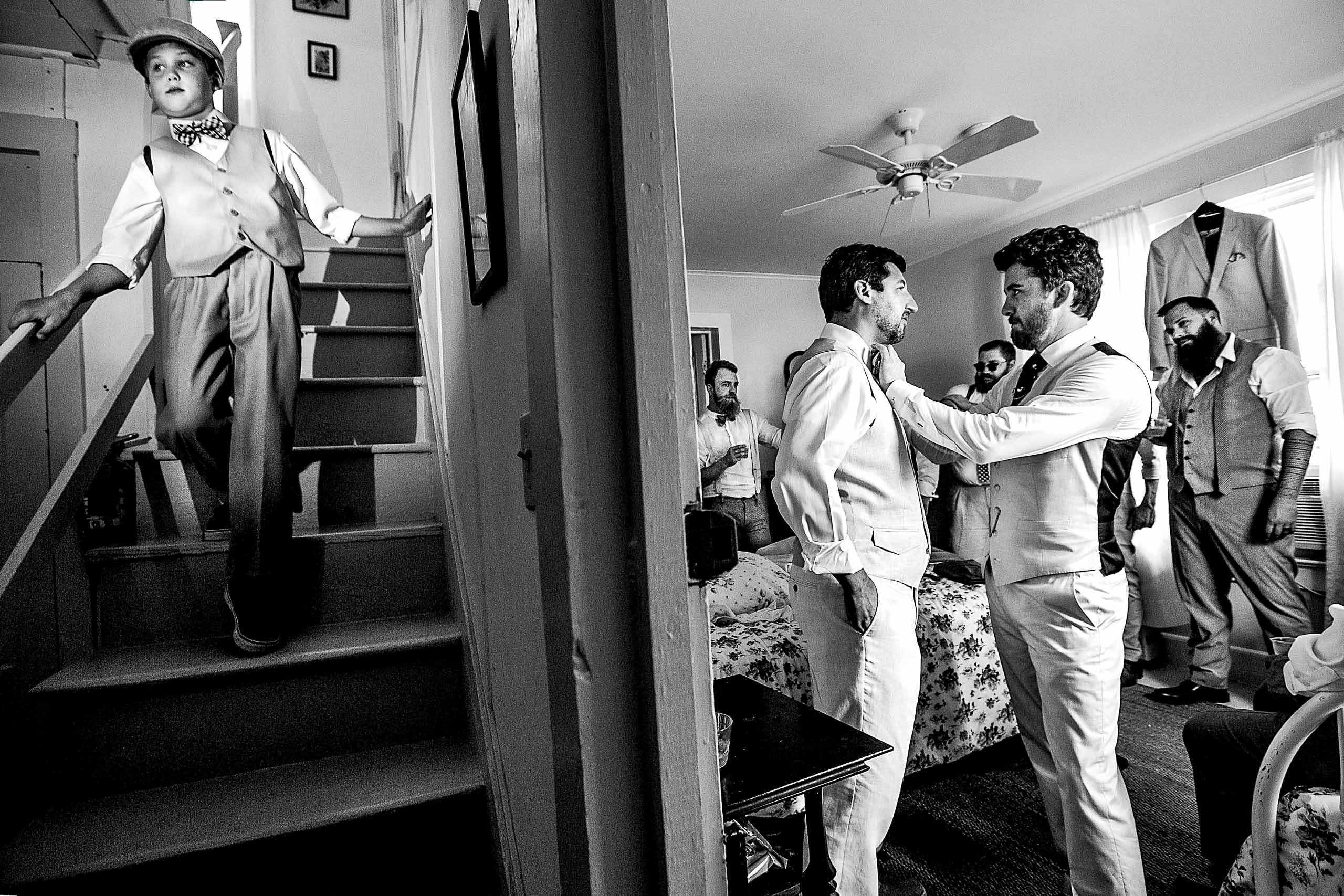 Groom helping friends get ready for his Chesapeake Bay wedding in Maryland at Wades Point Inn.