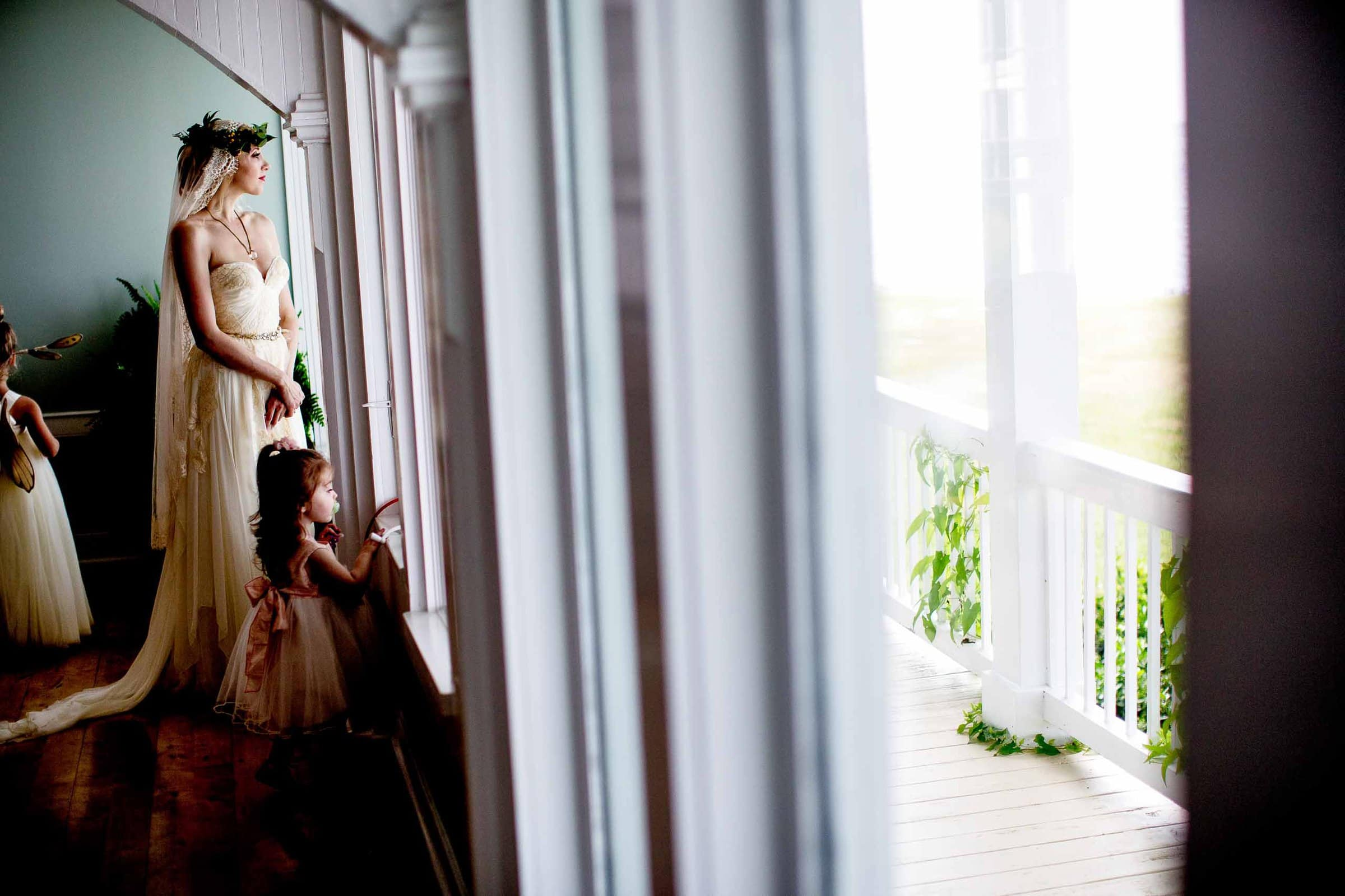 Bride reflecting out the window before her Chesapeake Bay wedding in Maryland at Wades Point Inn.
