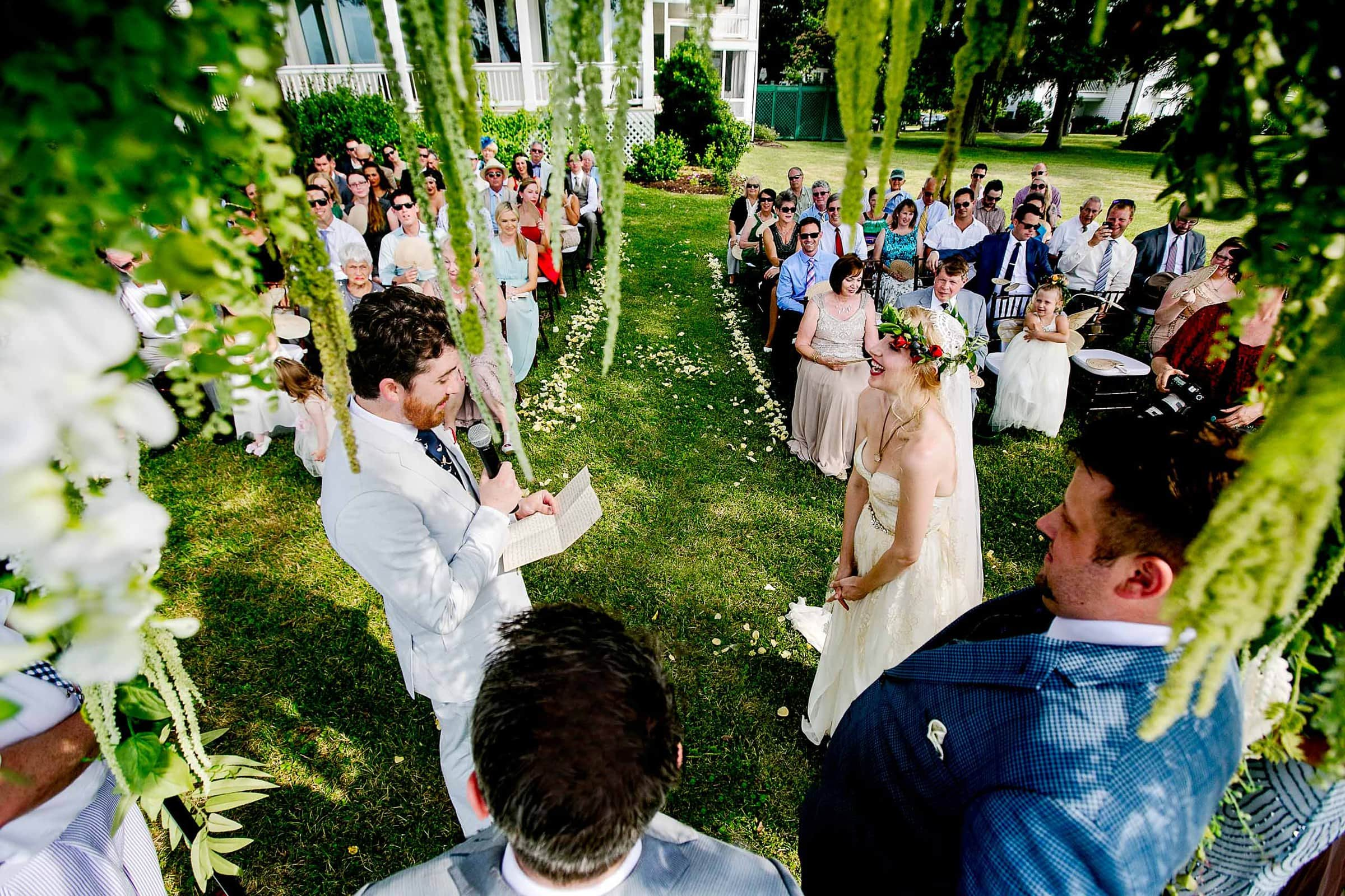 Wide angle perspective of a ceremony during a Chesapeake Bay wedding in Maryland at Wades Point Inn.