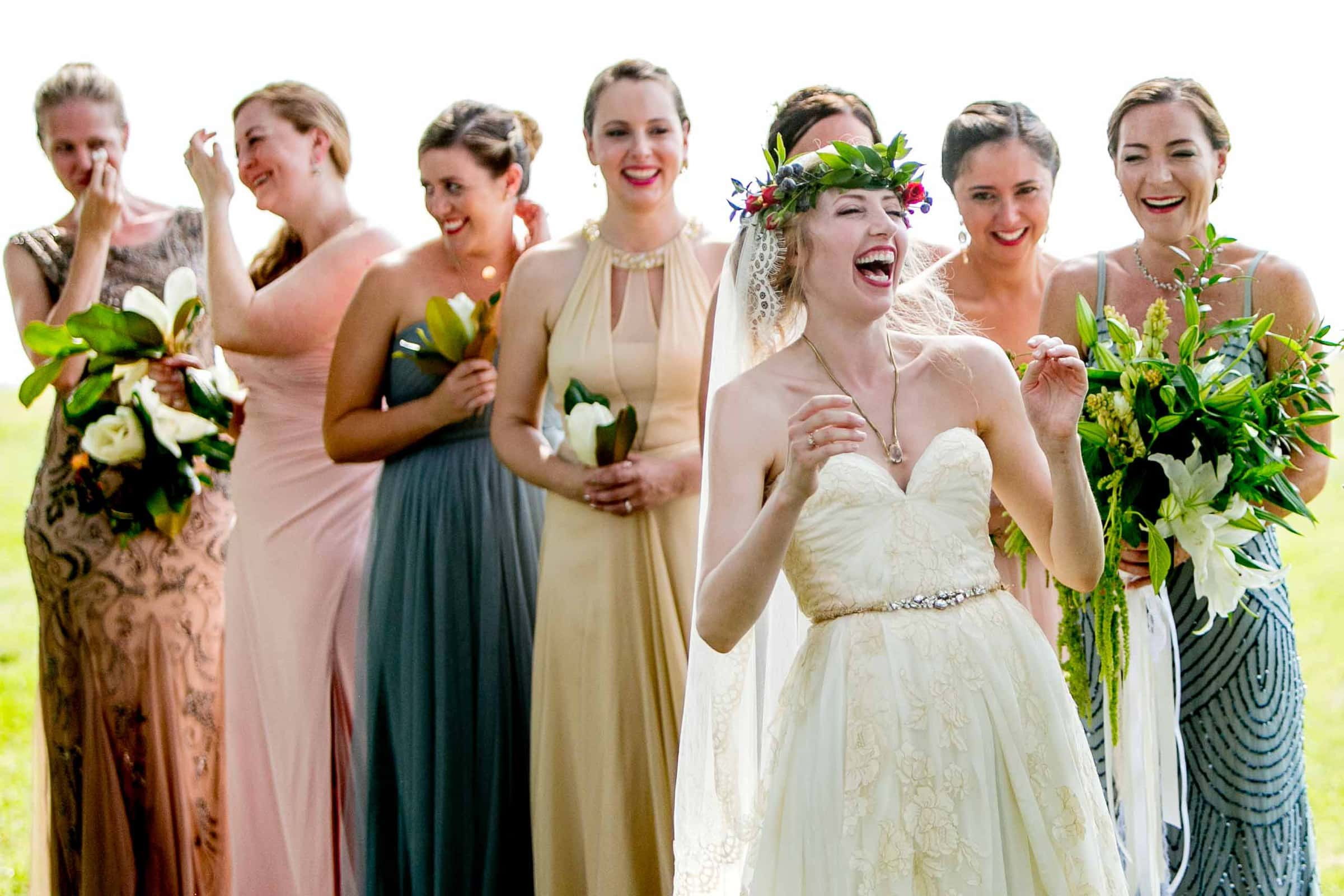 Fun photo of a bride laughing in the ceremony during a Chesapeake Bay wedding in Maryland at Wades Point Inn.
