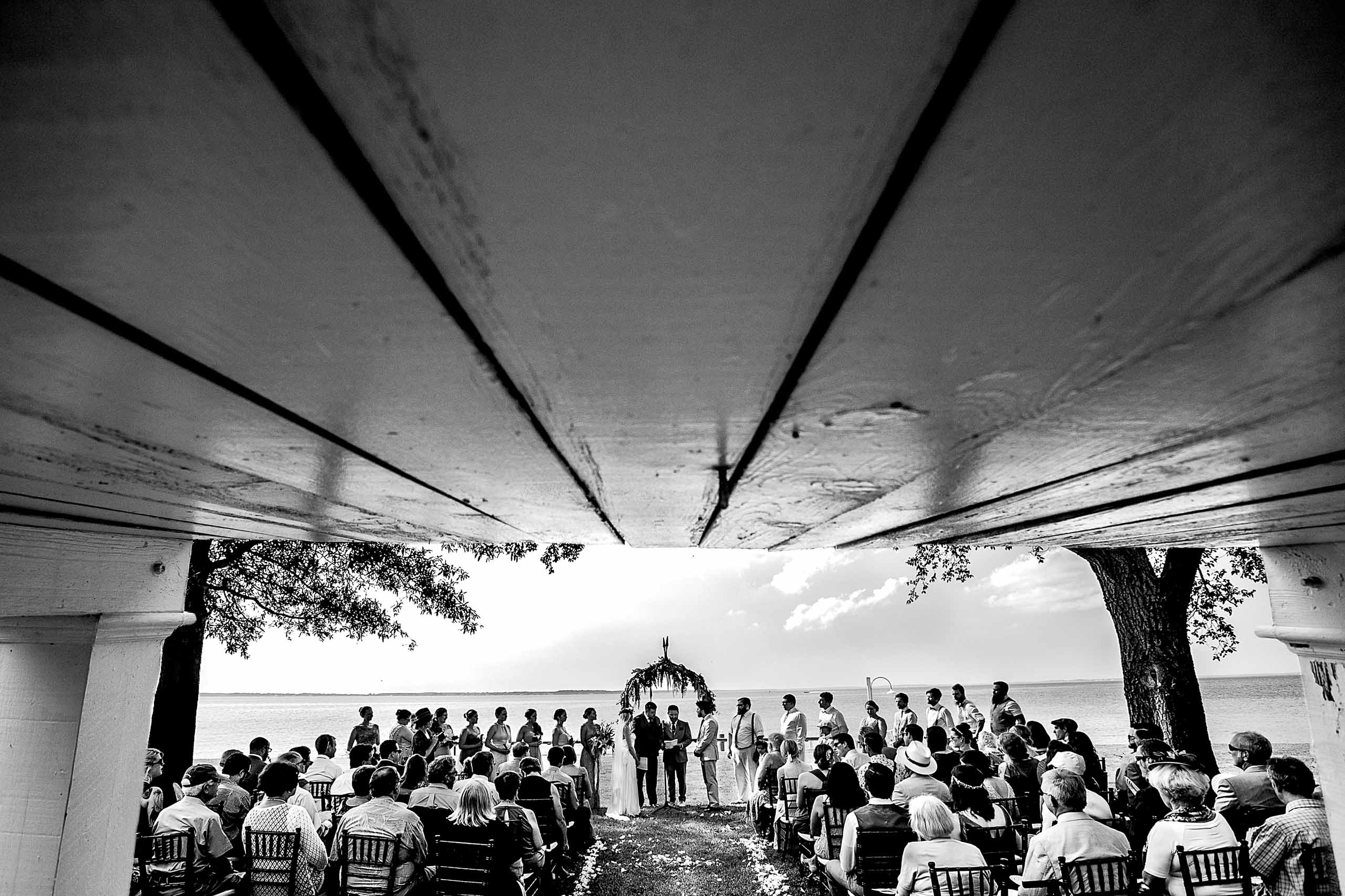 Wide angle perspective during a Chesapeake Bay wedding ceremony in Maryland at Wades Point Inn.