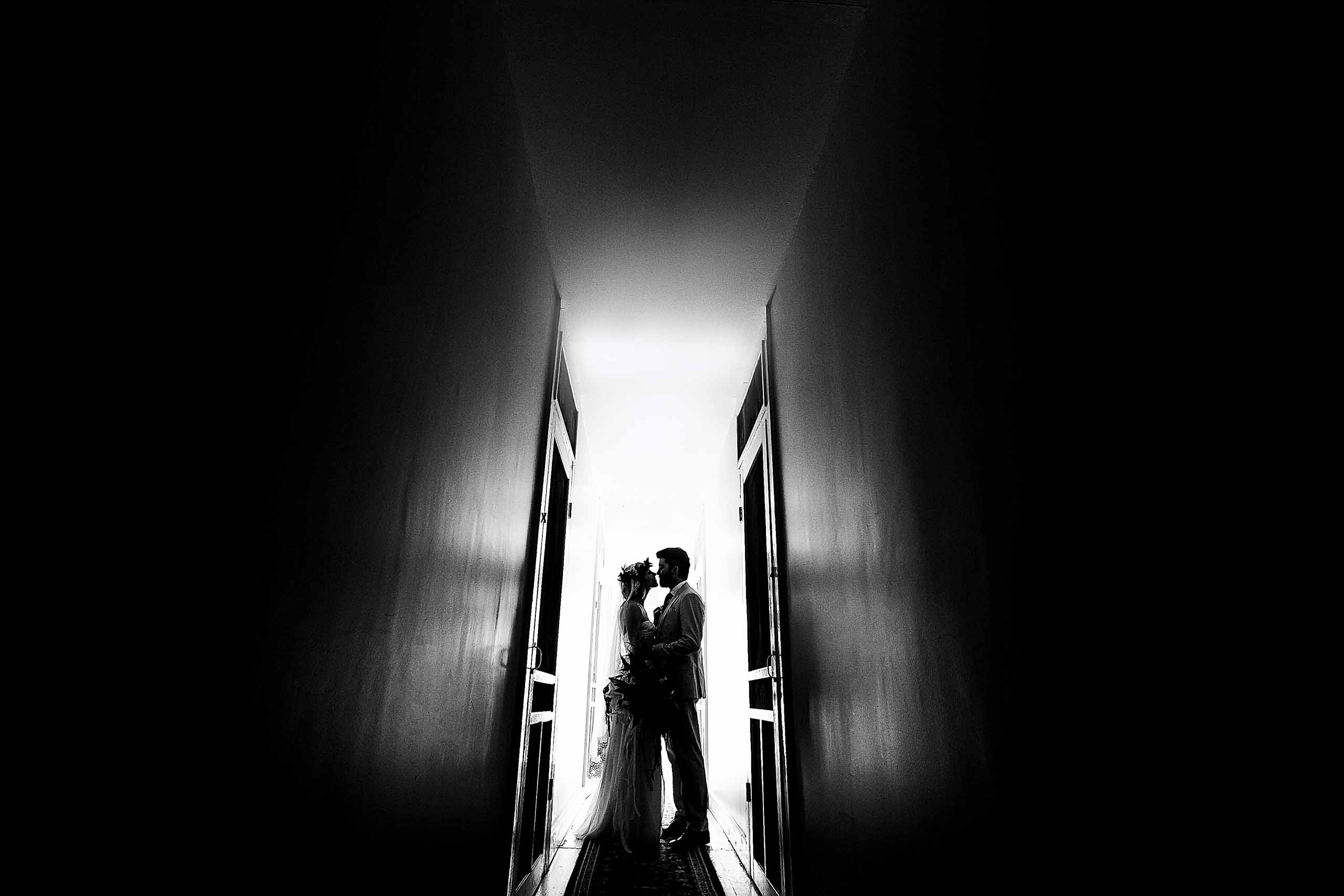 Bride and groom silhouette photo moments after their gorgeous Chesapeake Bay wedding ceremony in Maryland at Wades Point Inn.