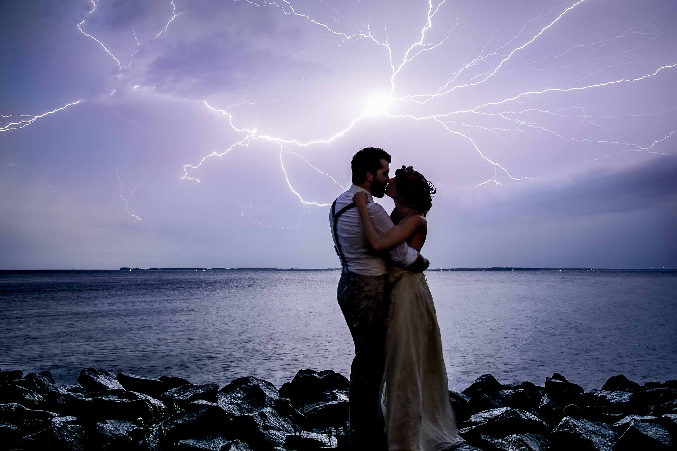 Bride and Groom captured with Lightning over their heads. Fearless Award Winning Photo by josandtree