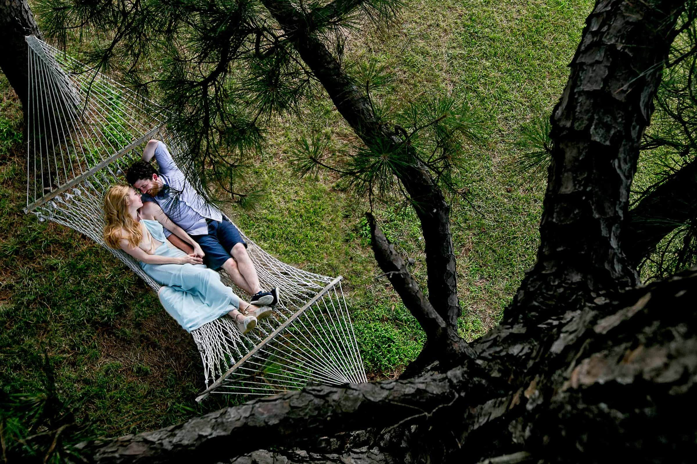 Photo of a Bride and groom resting in a hammock at their Chesapeake Bay wedding ceremony in Maryland at Wades Point Inn.