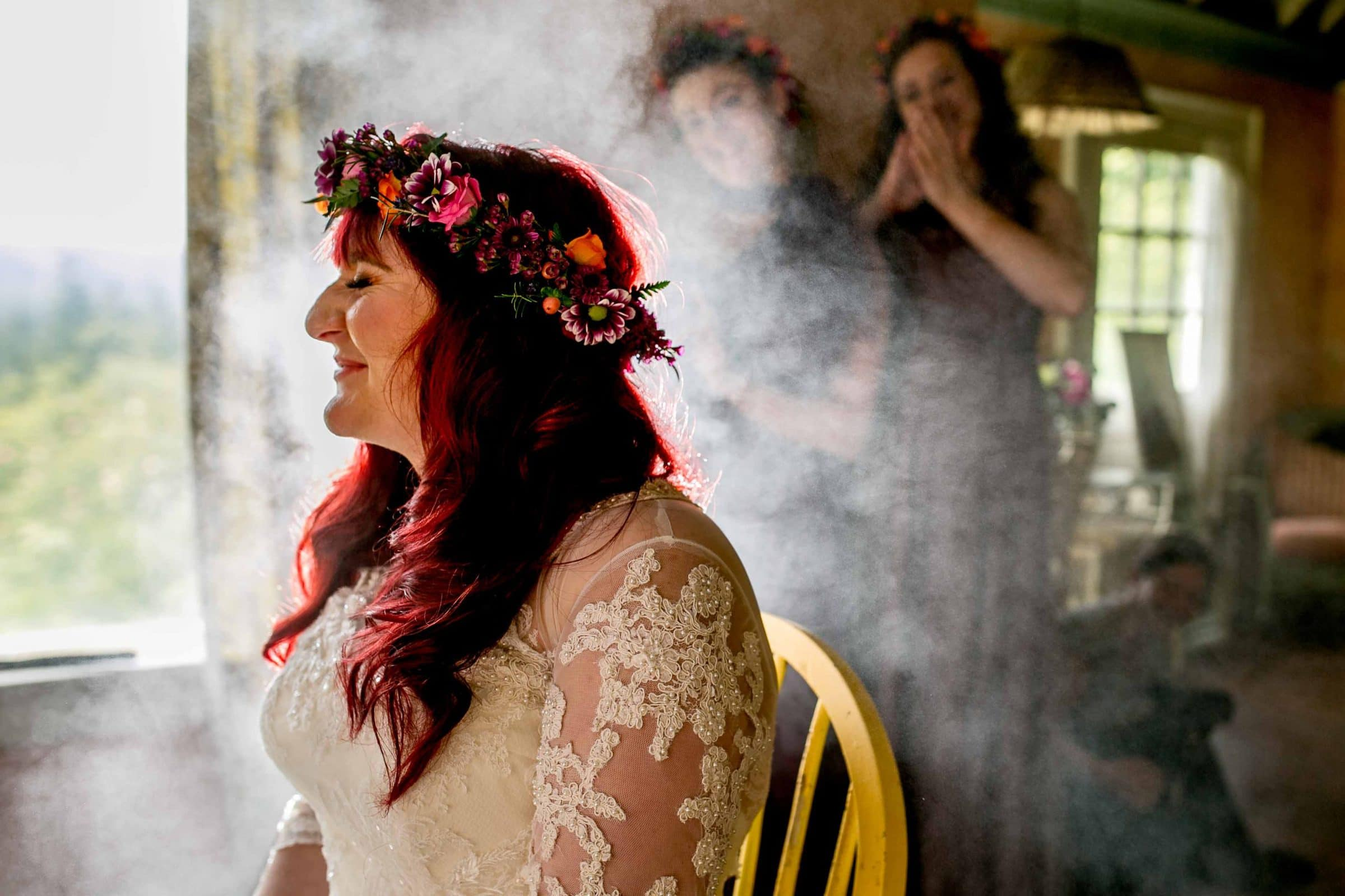 Dynamic lighting photo of a bride with bright red hair and hair spray all light up while getting ready for her Mt Hood Organic Farms Wedding