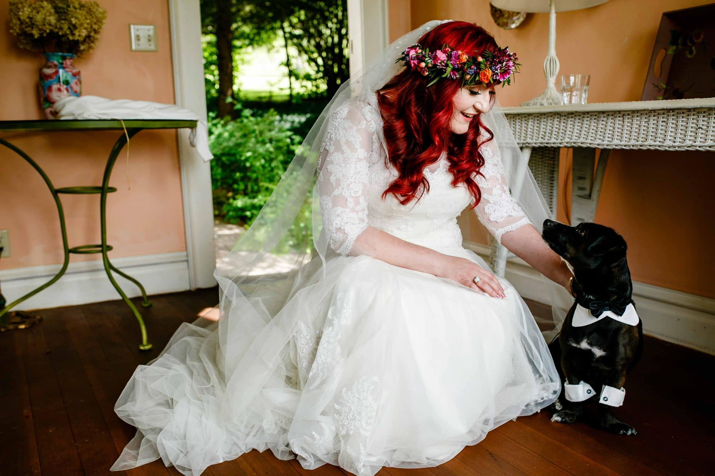 A colorful bride with her friendly little dog before her Mt Hood Organic Farms Wedding ceremony in the orchard house.