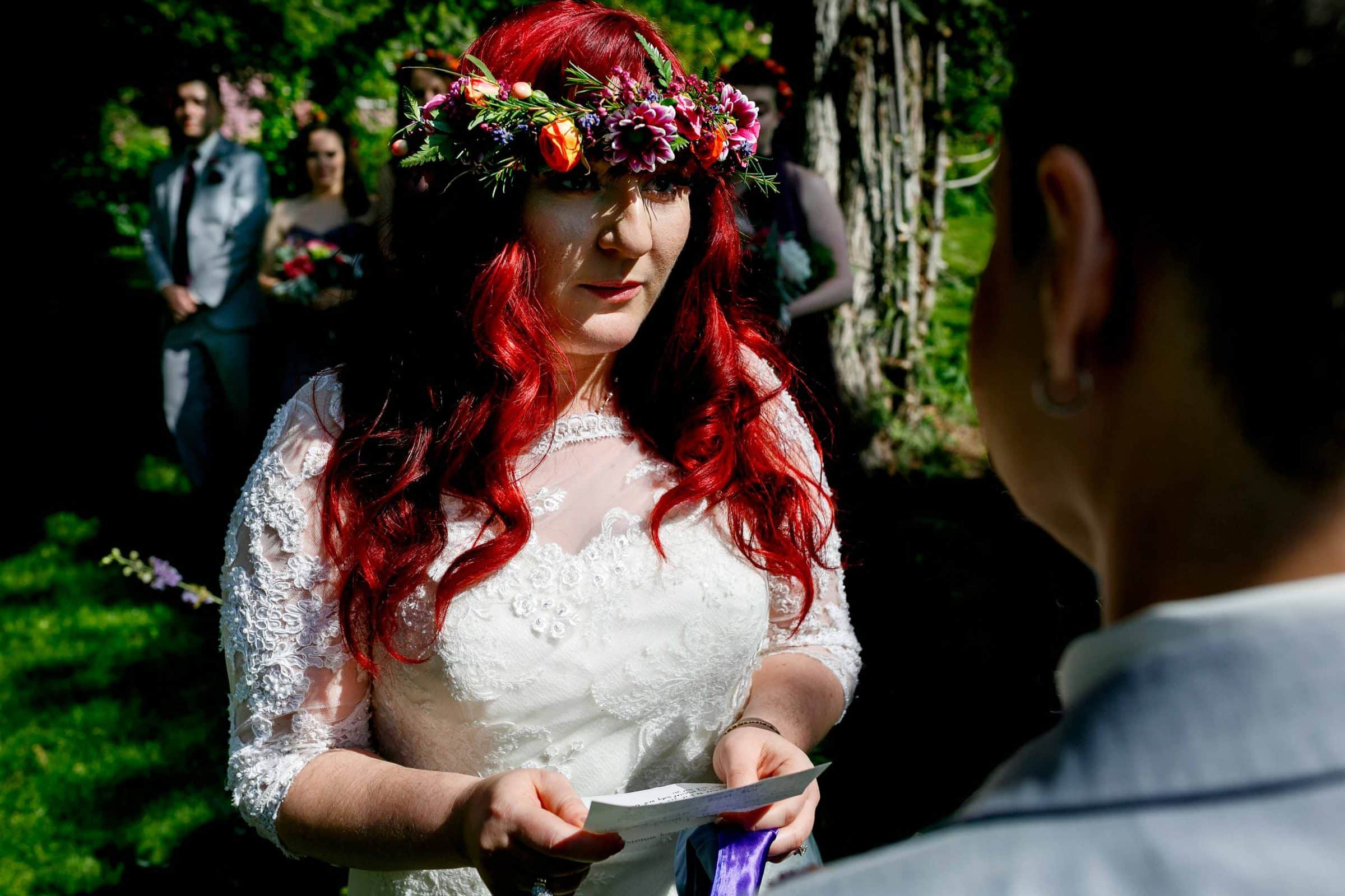 A colorful bride saying her vows during a Mt Hood Organic Farms wedding ceremony