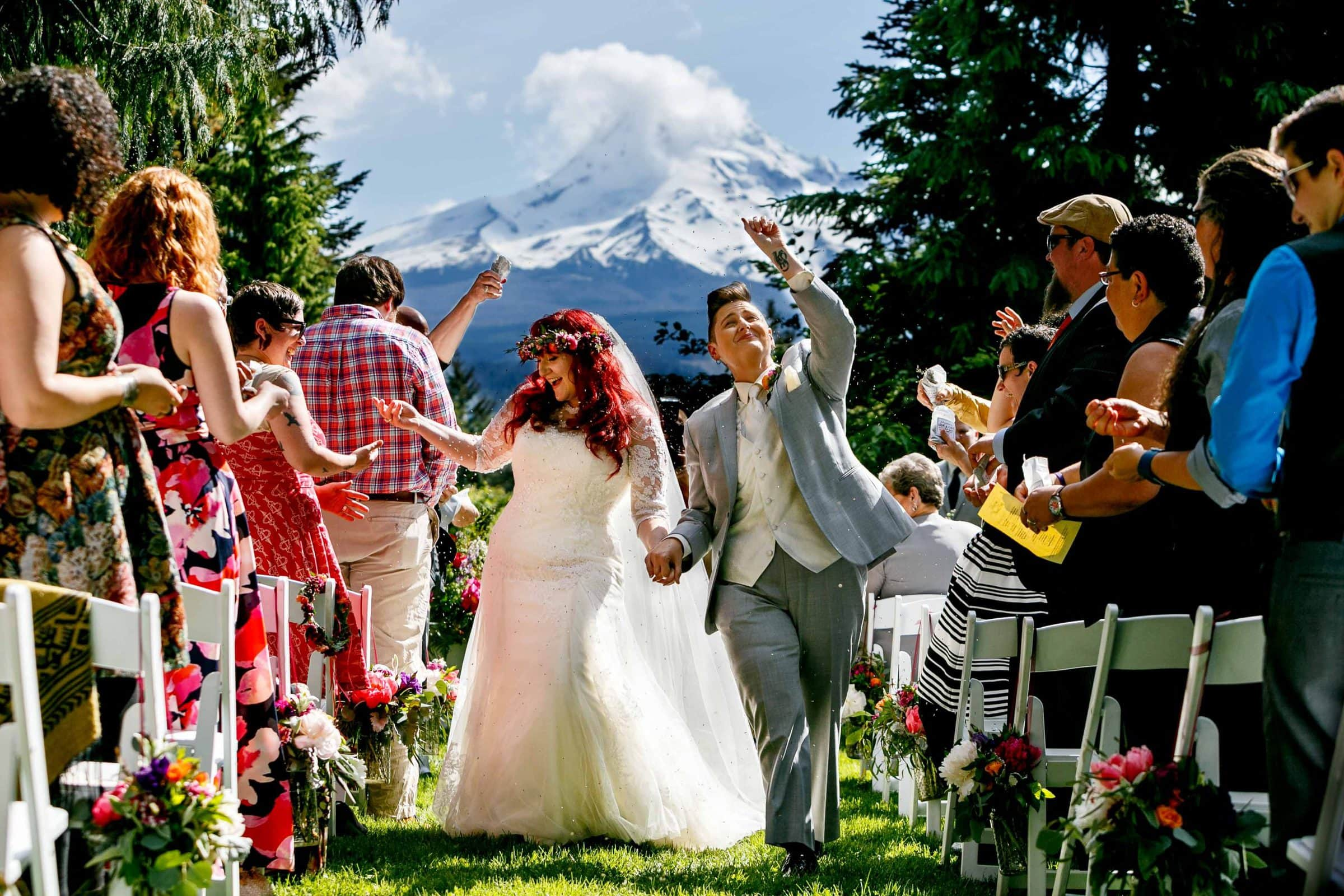A spectacular award winning wedding photo of a bride and a bride enjoying their exit during their Mt Hood Organic Farms wedding ceremony