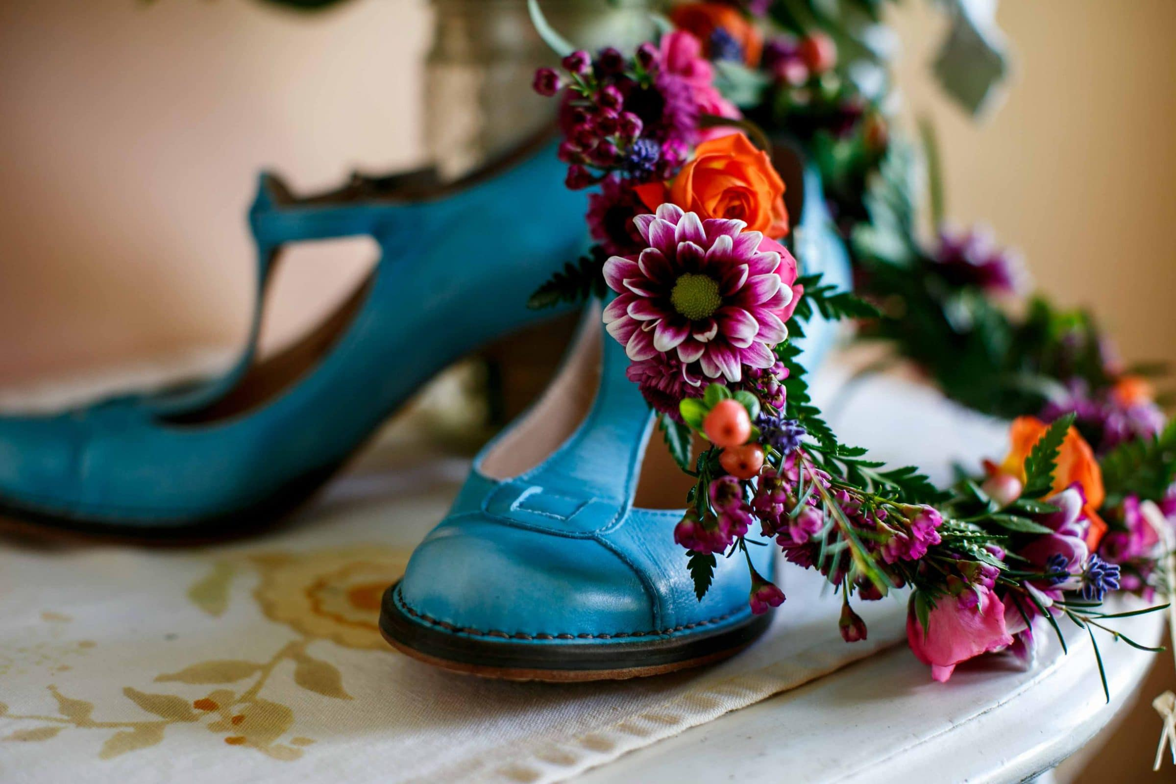 Gorgeous teal color brides shoes with flowers at Mt Hood Organic Farms