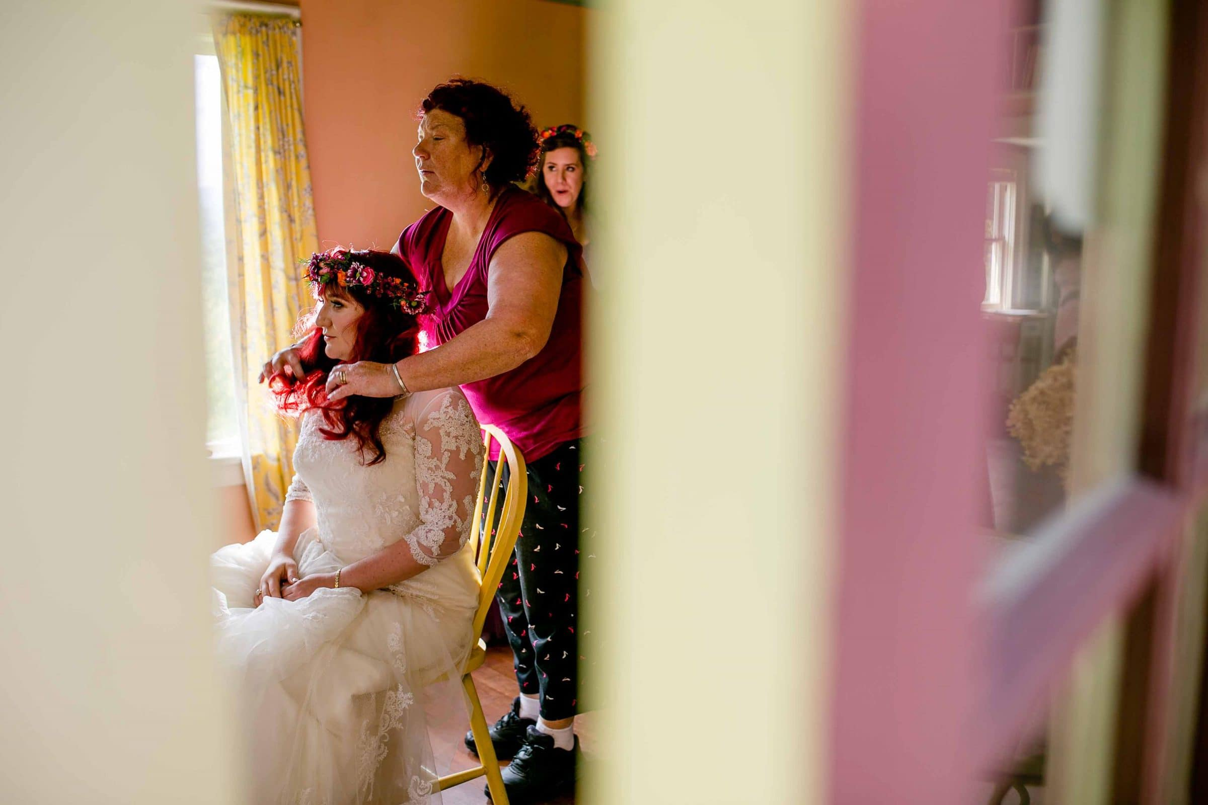 A storytelling photo of a bride getting ready for her Mt Hood Organic Farms Wedding ceremony