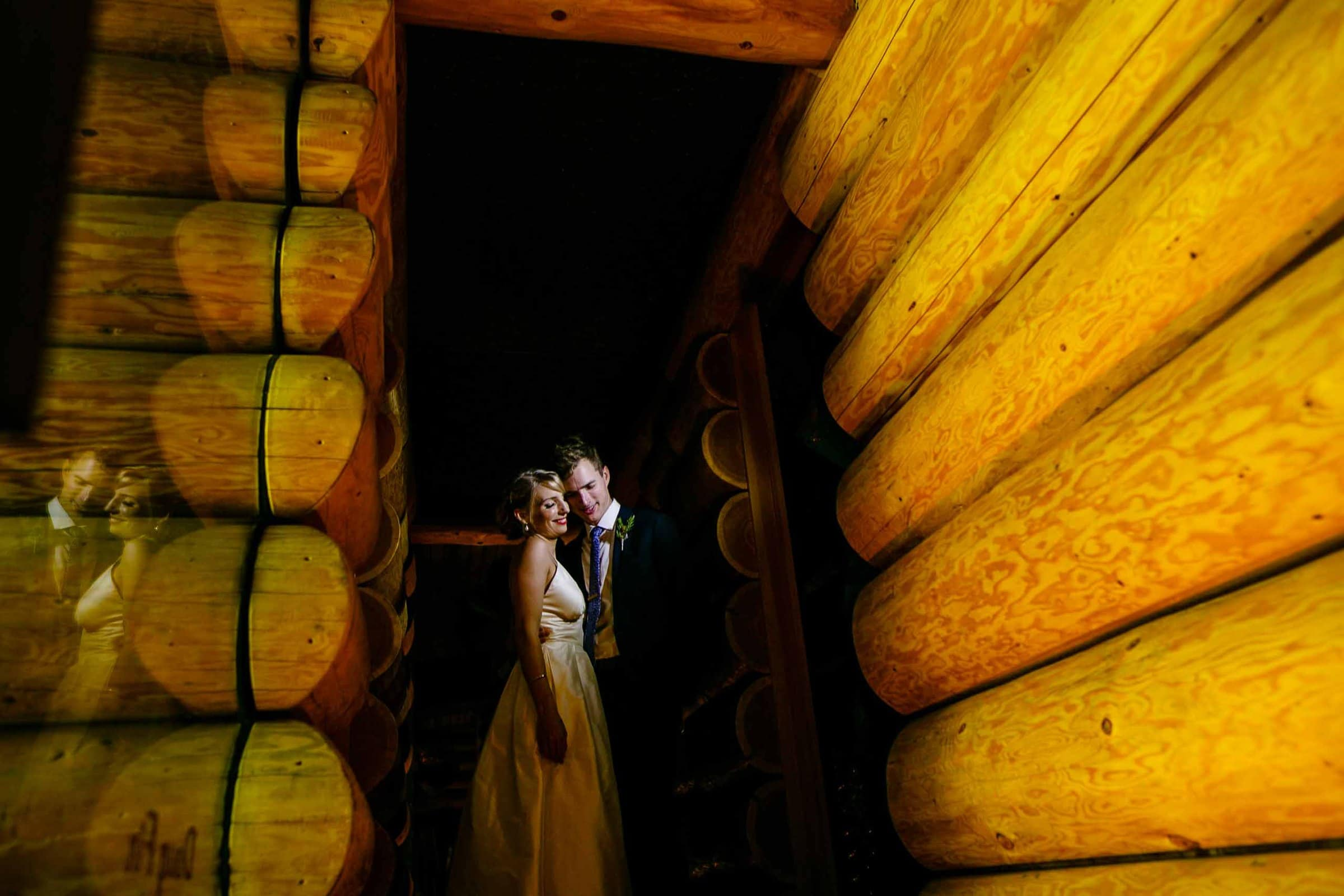a creative photo of a bride and groom at Jupiter Hotel with a reflection in the mirror before heading out to their camp angleos wedding