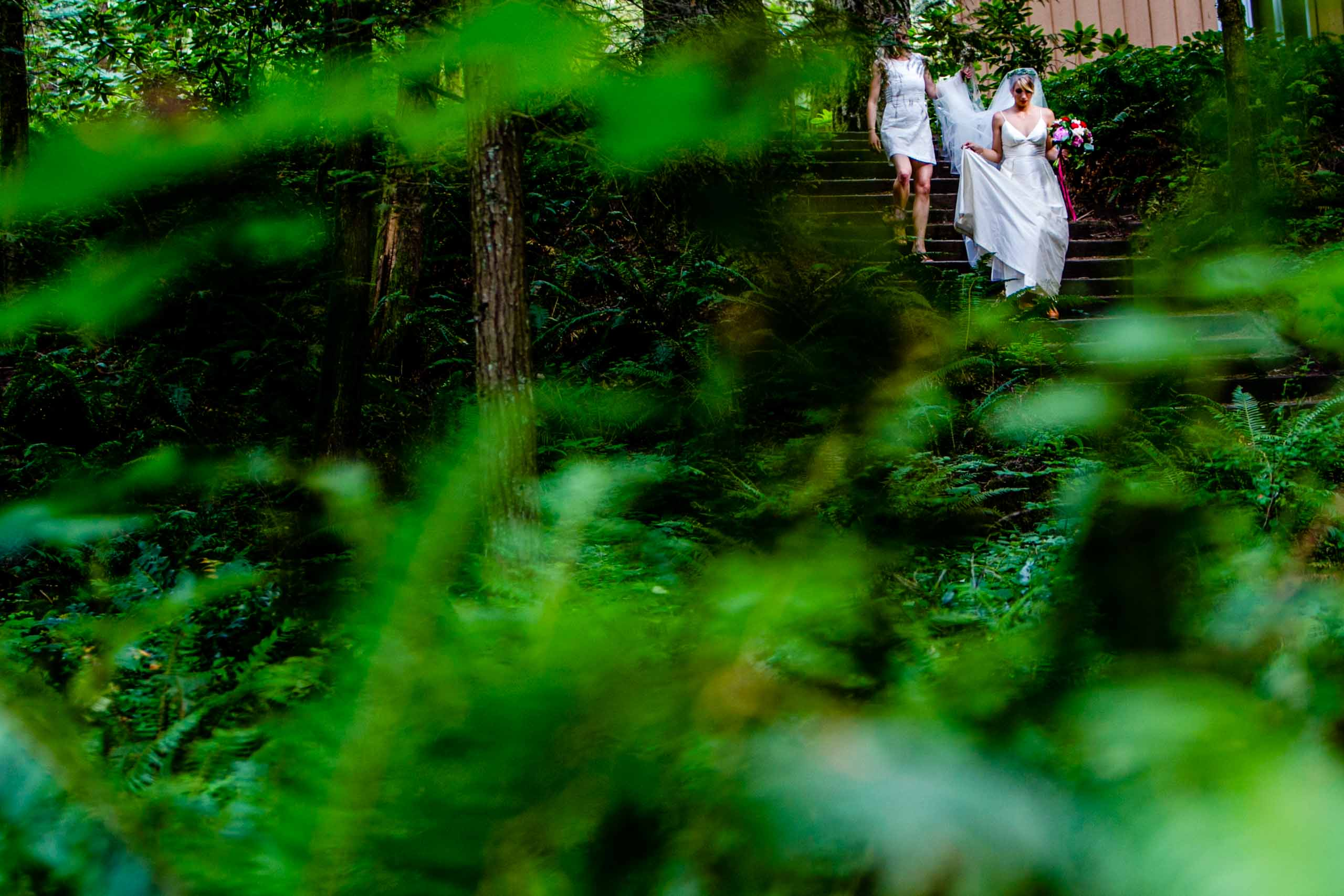 A bride walking through the woods heading into her camp angleos wedding ceremony with Luxe Productions