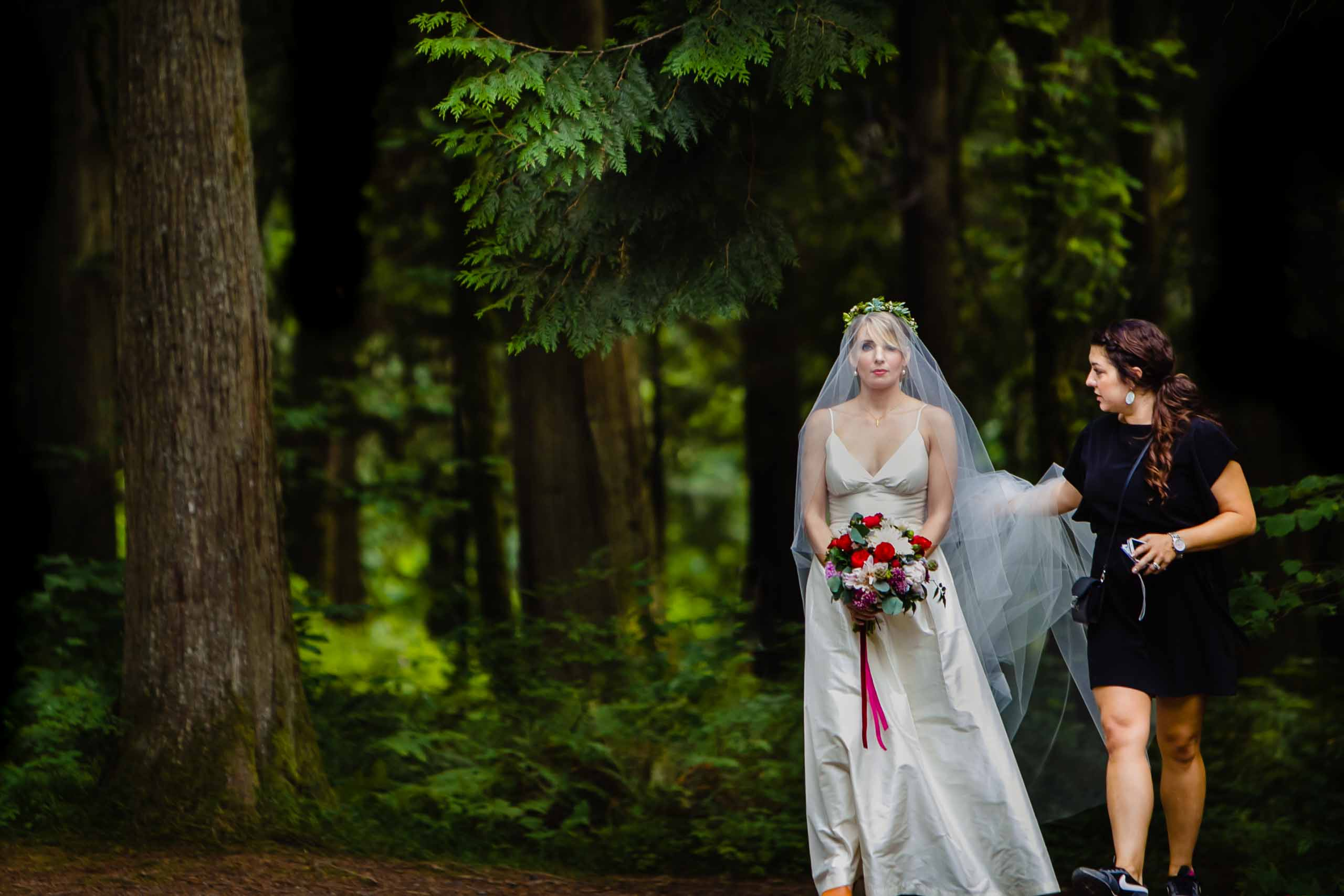 A bride walking with Misty Daminco while heading into her camp angleos wedding ceremony with Luxe Productions