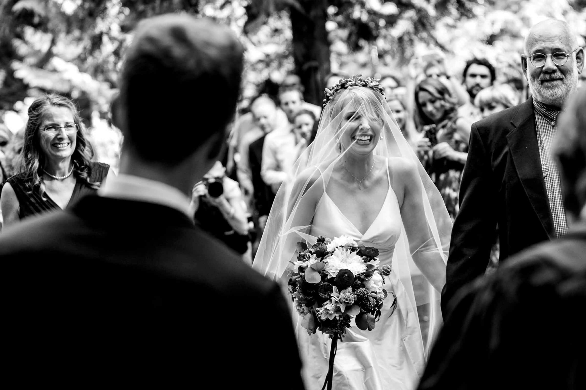 an emotional bride walking into her camp angleos wedding ceremony in Oregon