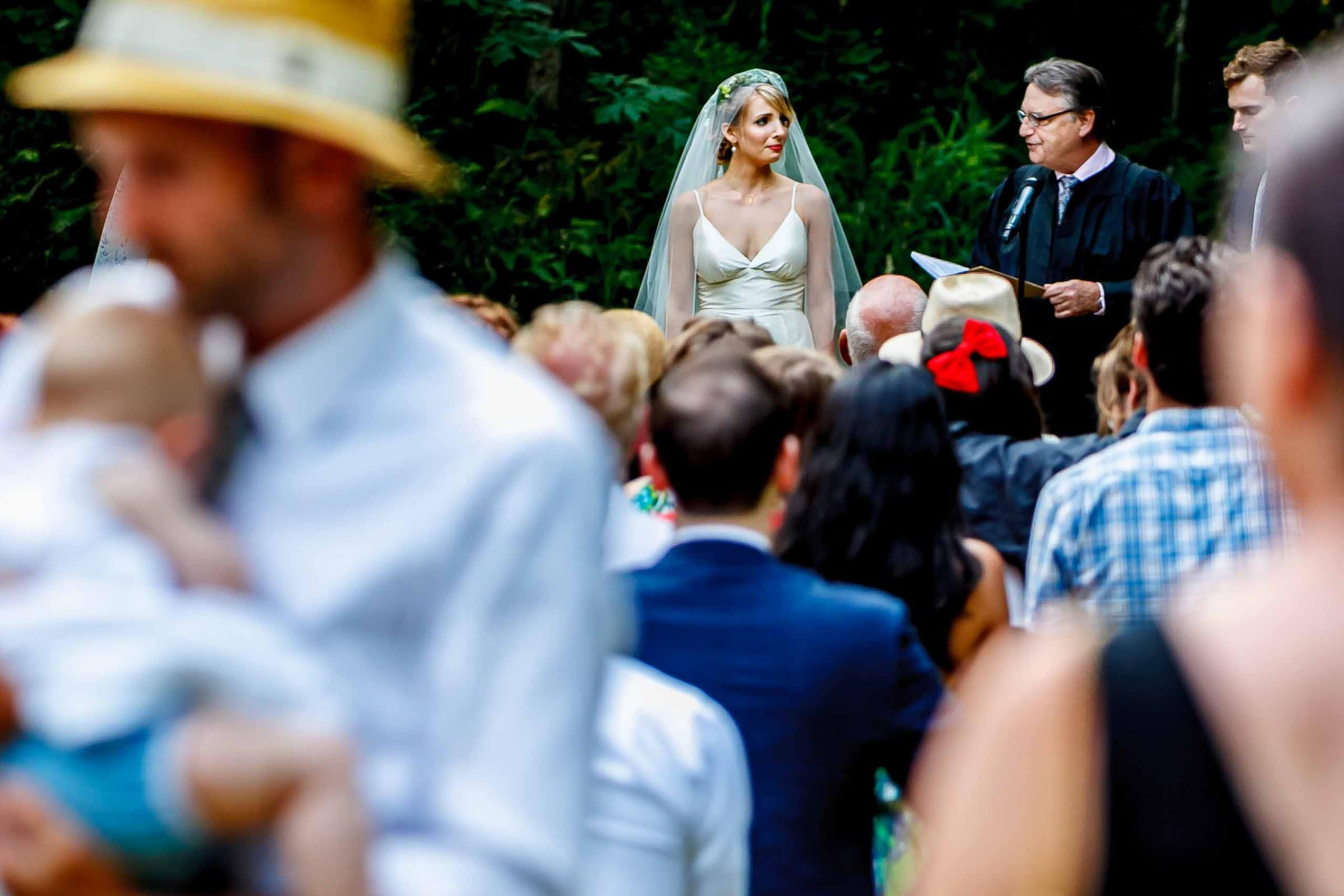 An emotional photo of a bride exchanging vows during a camp angleos wedding ceremony in Oregon