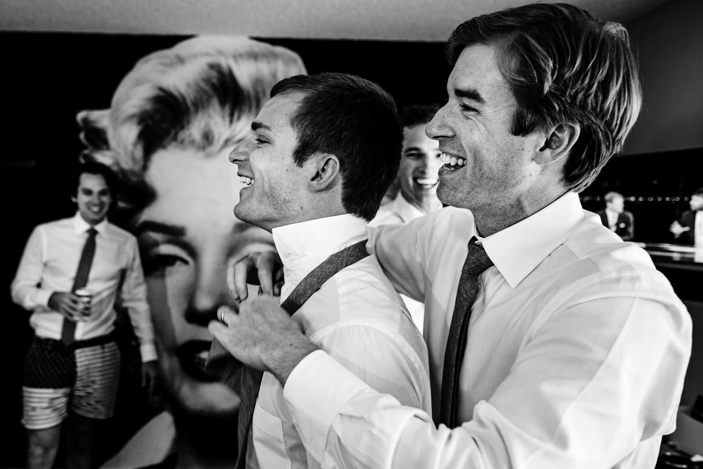 A fun photo of groosmen getting ready at Jupiter Hotel before heading out to their camp angleos wedding