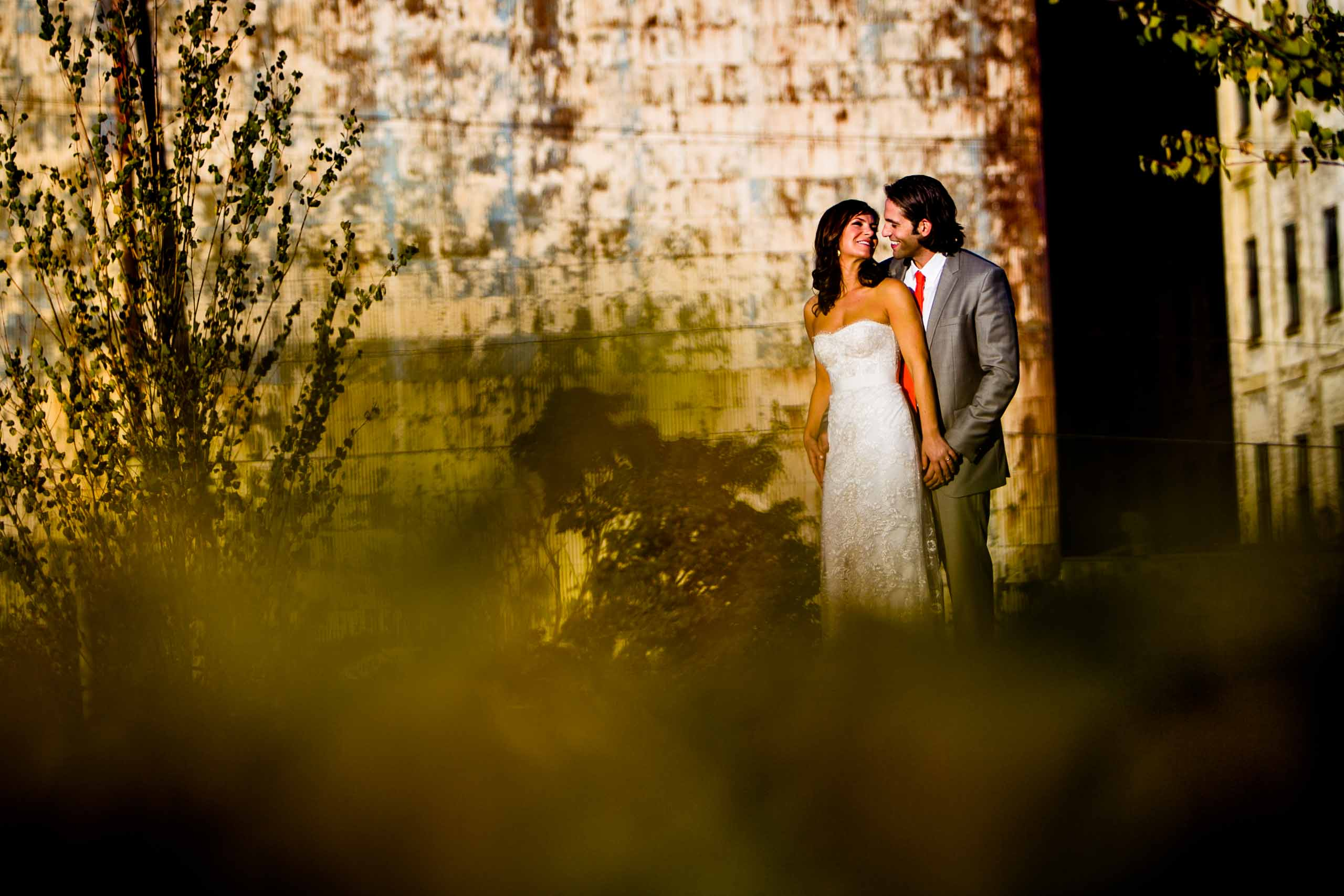 Bride and groom portrait at sunset with rustic Portand backdrops during their Castaway Portland wedding celebration