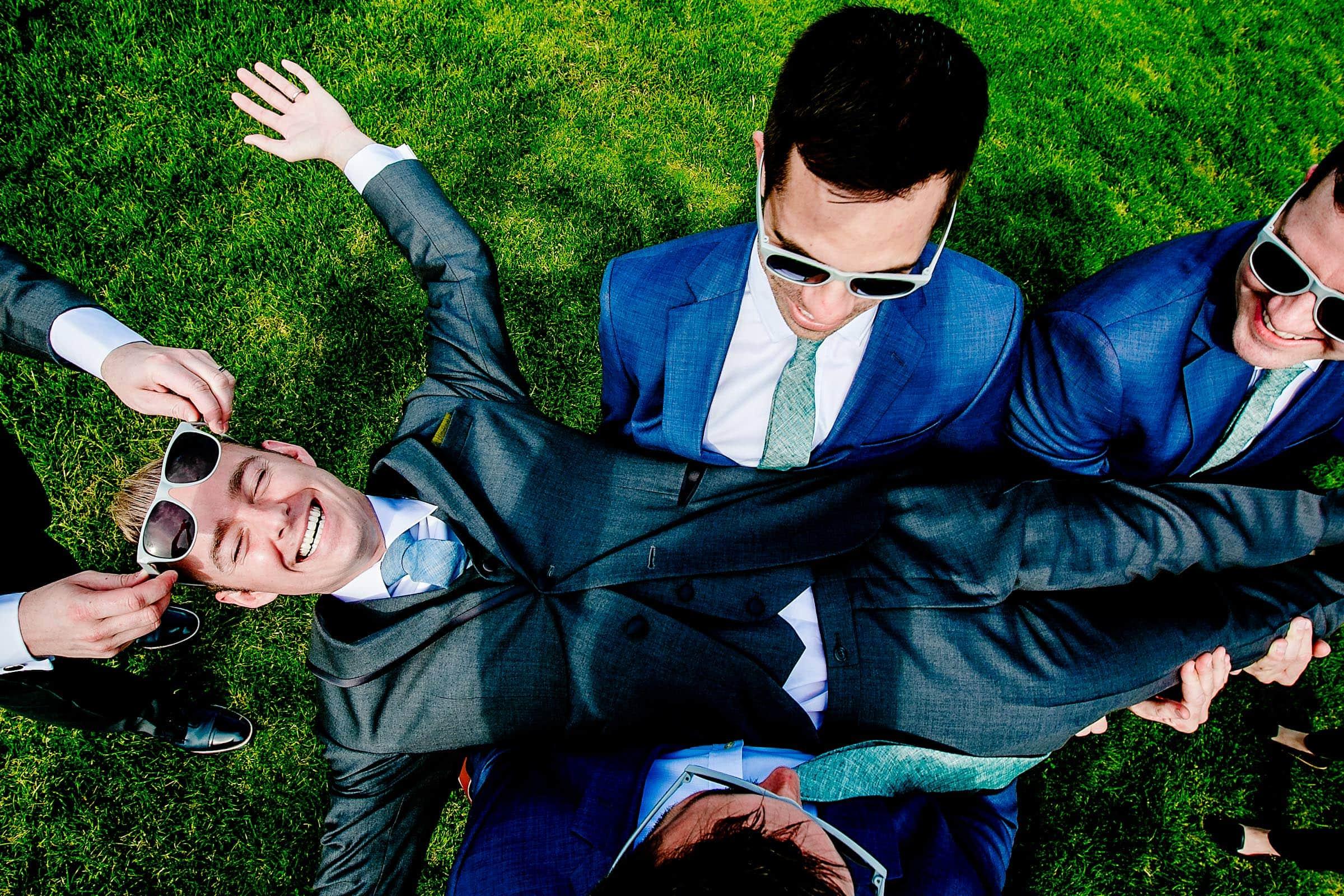 Fun candid photo of groomsmen on their way to a Castaway Portland wedding