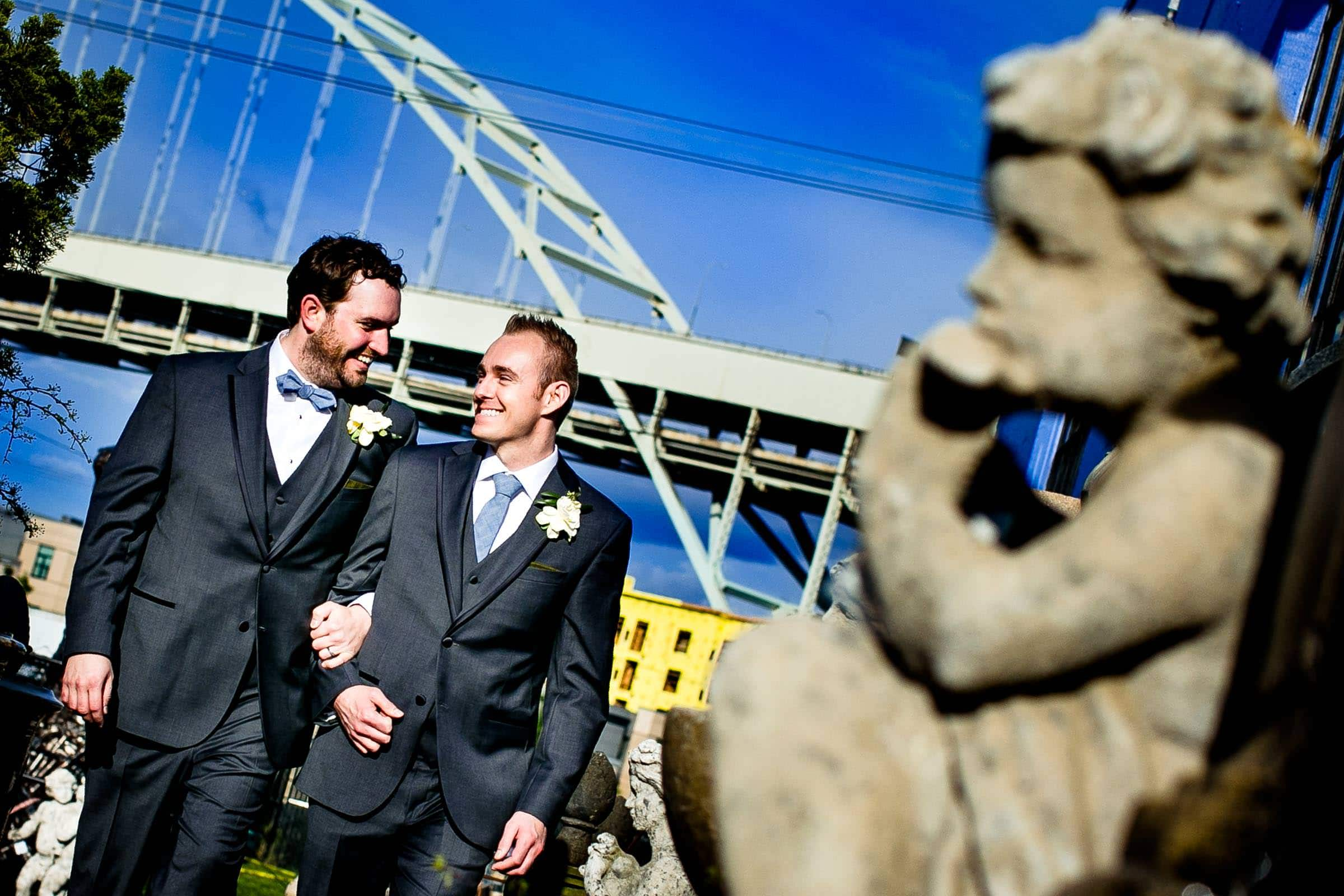 Grooms walking into their Castaway Portland wedding ceremony