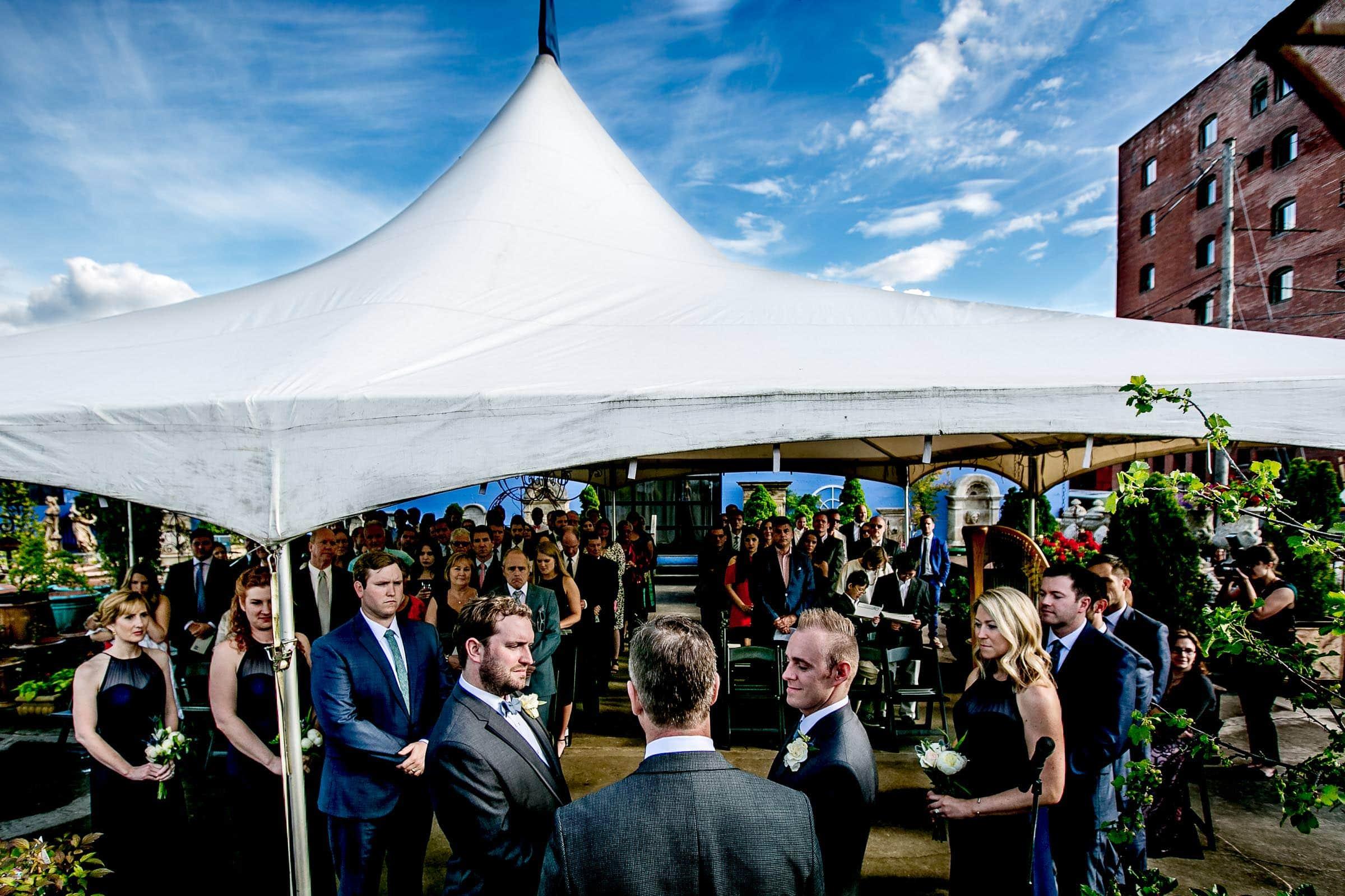 Same sex wedding ceremony at Castaway Portland under a big tent