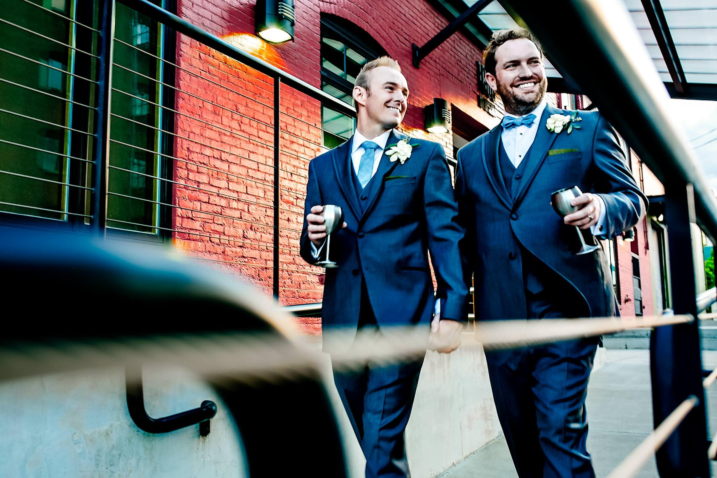 Grooms walking hand and hand during their Castaway Portland wedding
