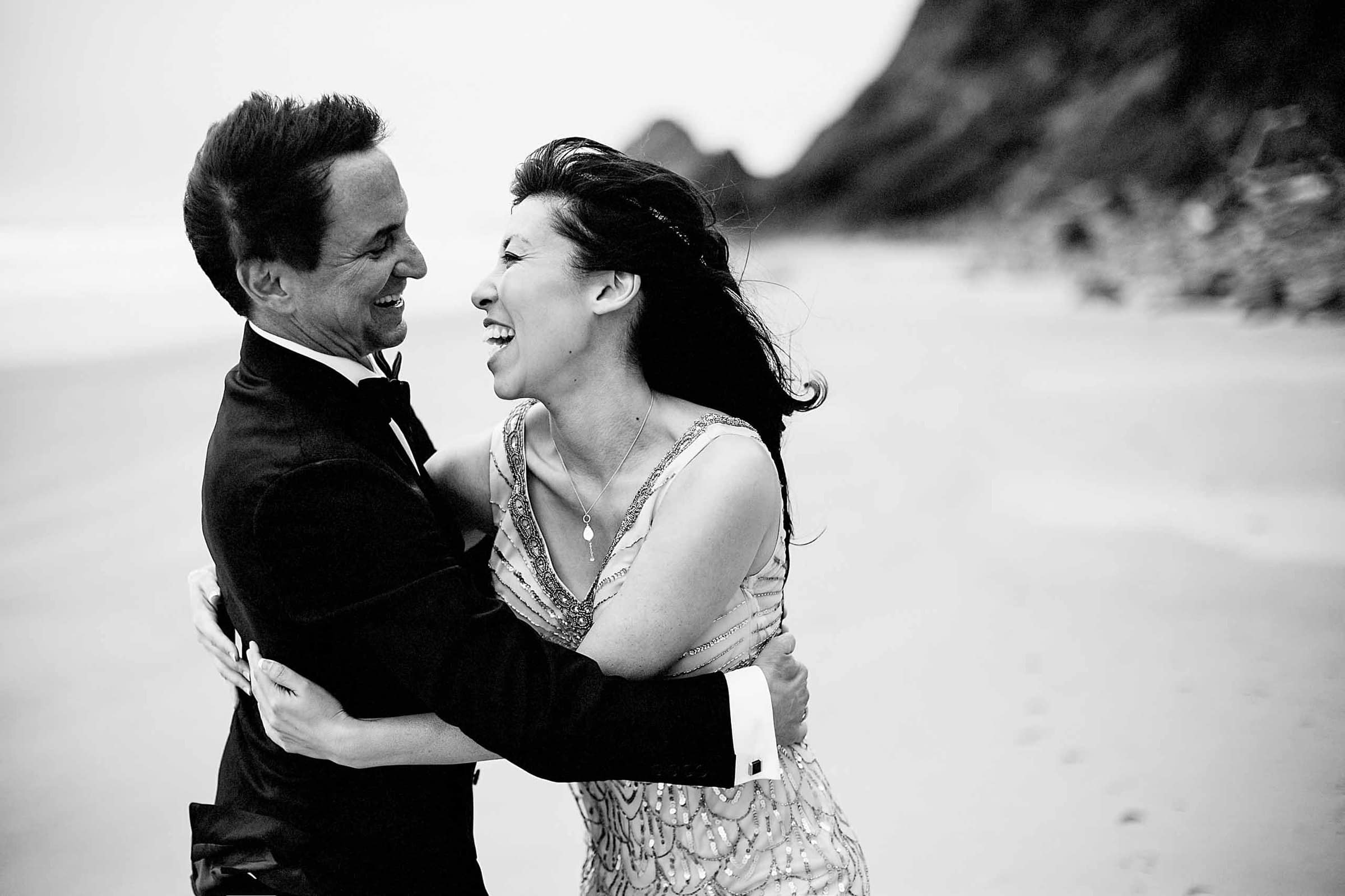 Joyous Bride and groom portrait on the beach during their Manzanita elopement in Oregon