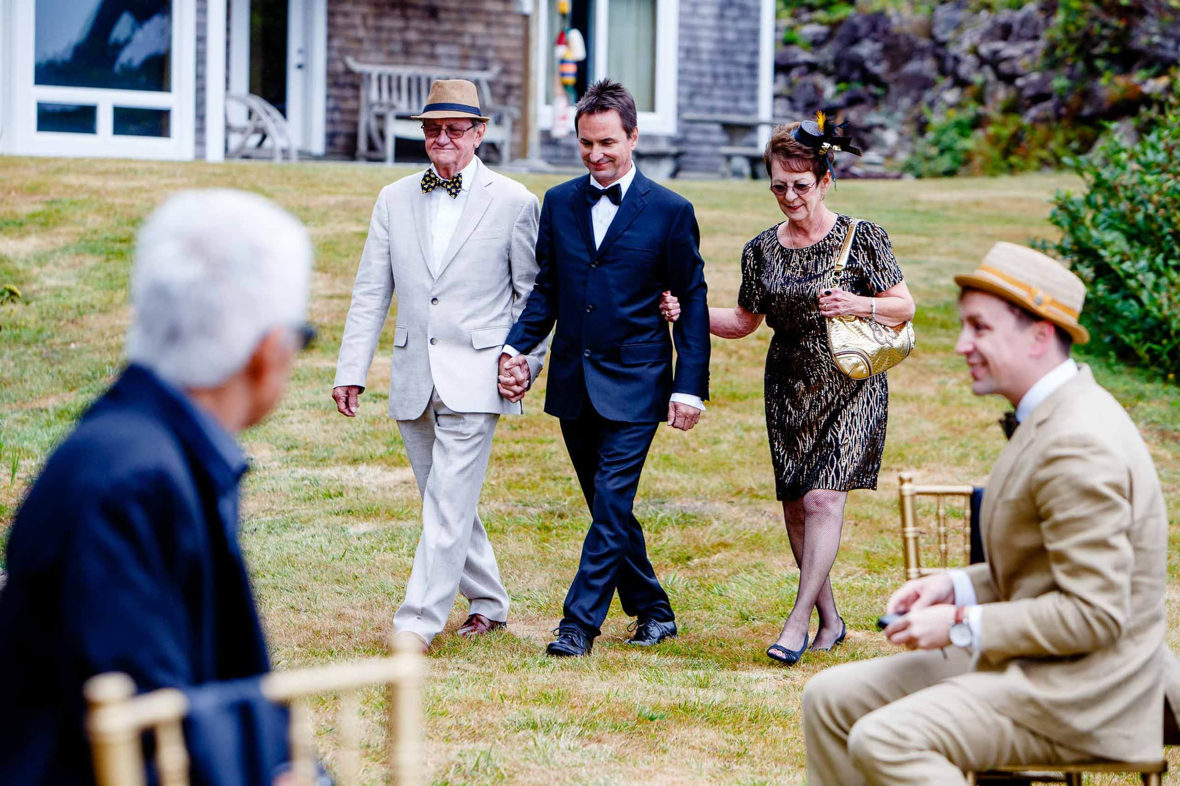 Groom walking into a private Manzanita elopement ceremony in Oregon with guests