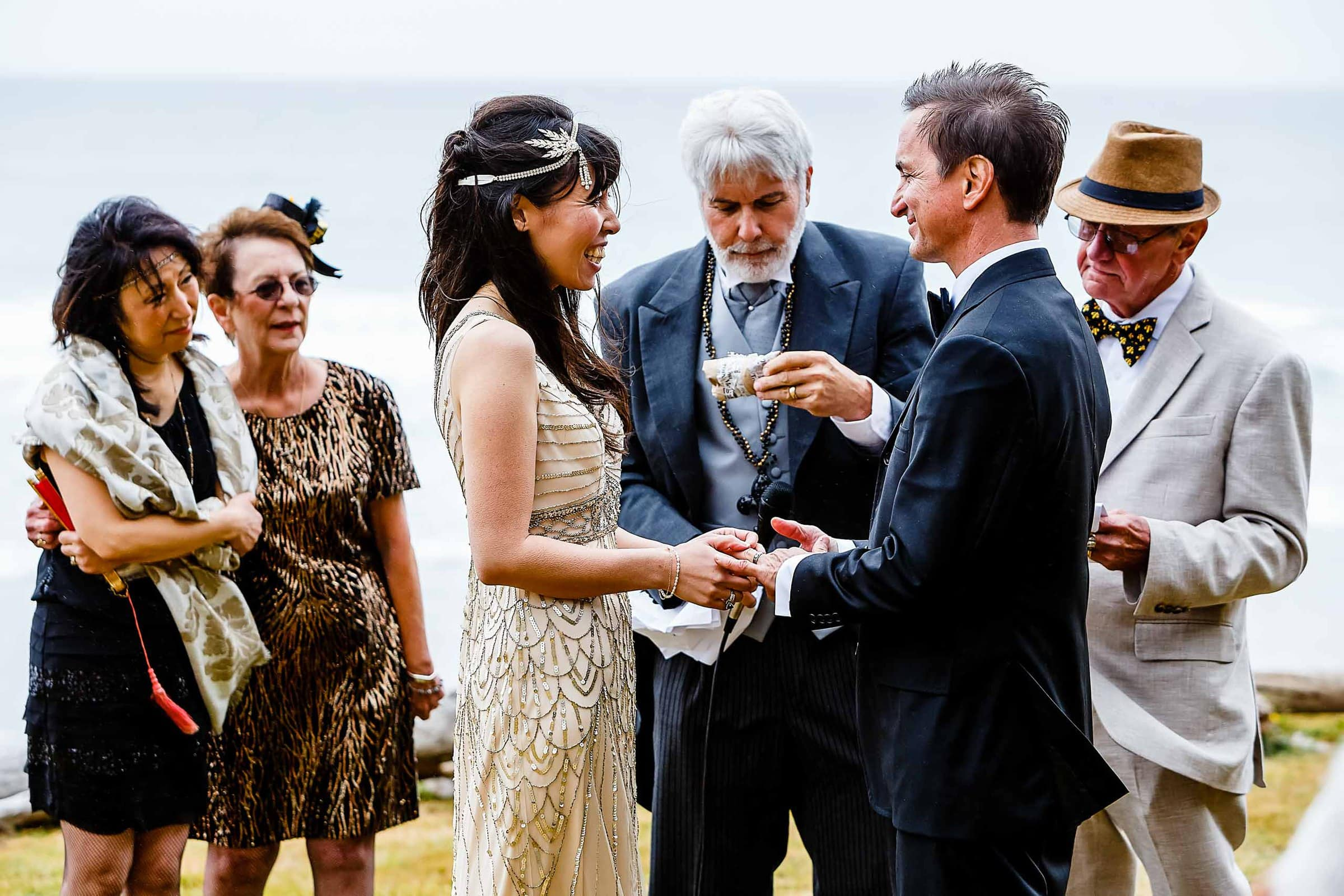 Bride and groom exchanging vows during their Manzanita elopement ceremony in Oregon