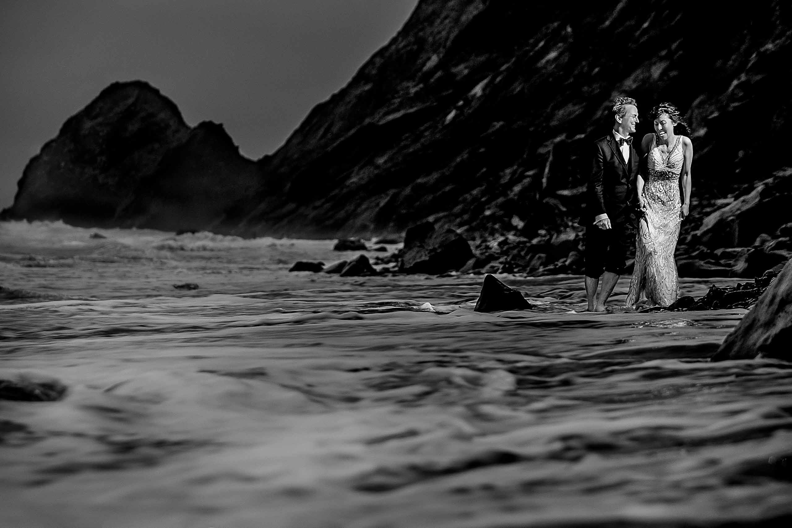 Bride and groom portrait of them walking near the ocean during their Manzanita Elopement in Oregon