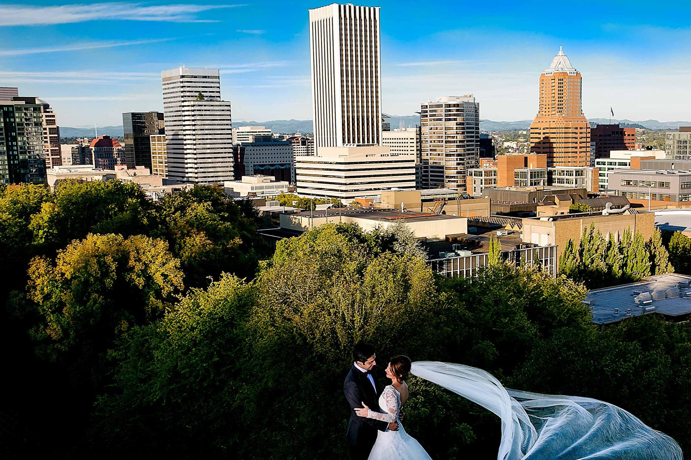 A panoramic view of Portland cityscape with a bride and groom during their Portland Persian wedding at the Portland Art Museum