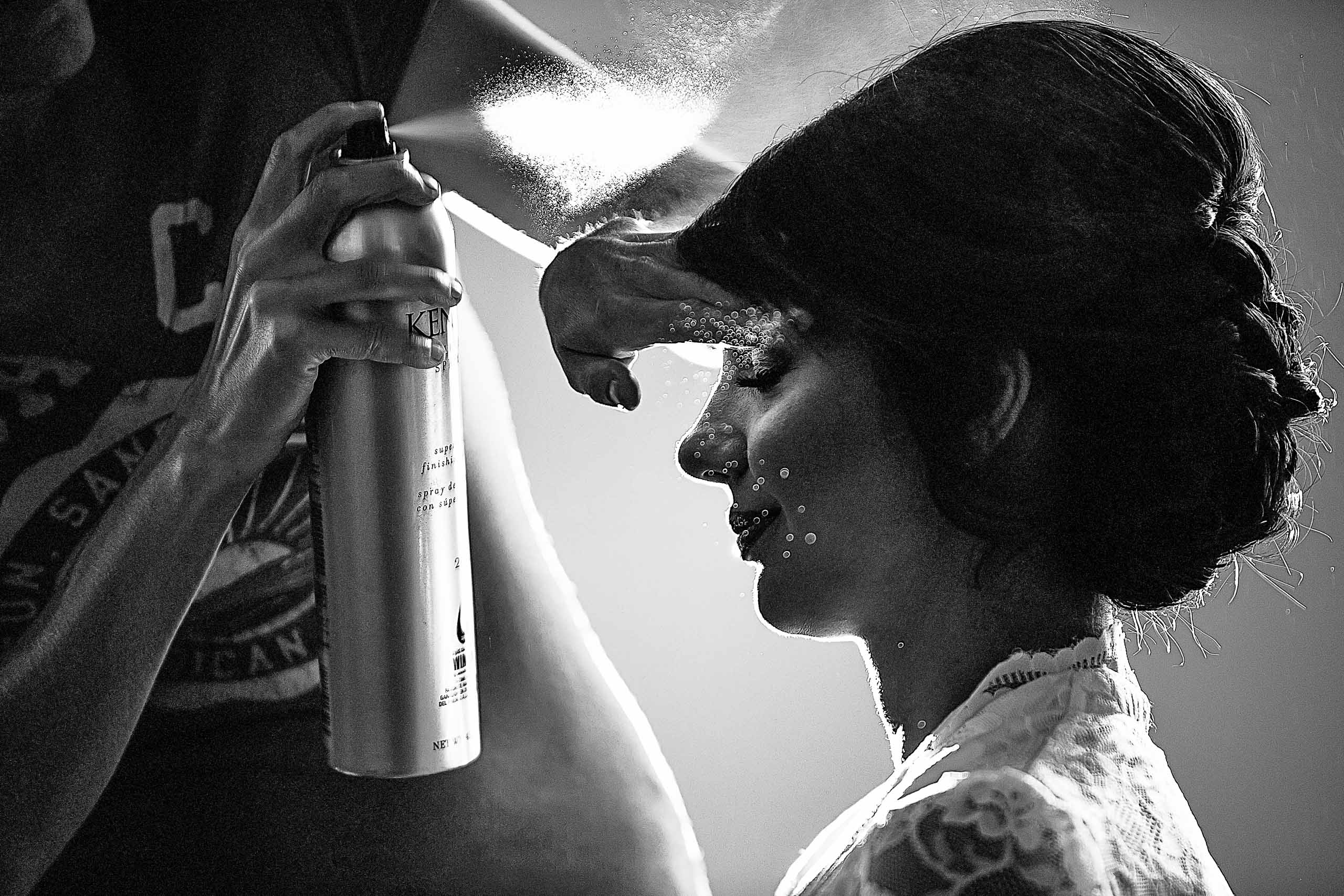 A lovely black and white documentary photo of a bride getting her hair done during her Portland Persian wedding at the Portland Art Museum in Portland's Park Blocks