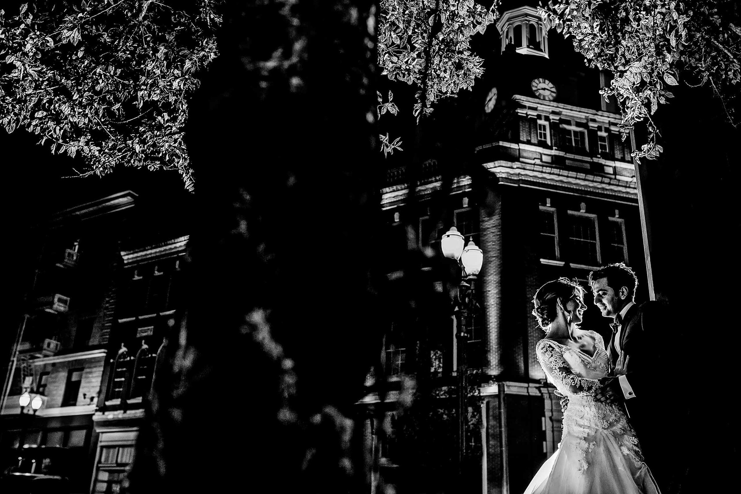 A creative night photo of a bride and groom in Portland's Park Blocks during their Portland Persian wedding at the Portland Art Museum