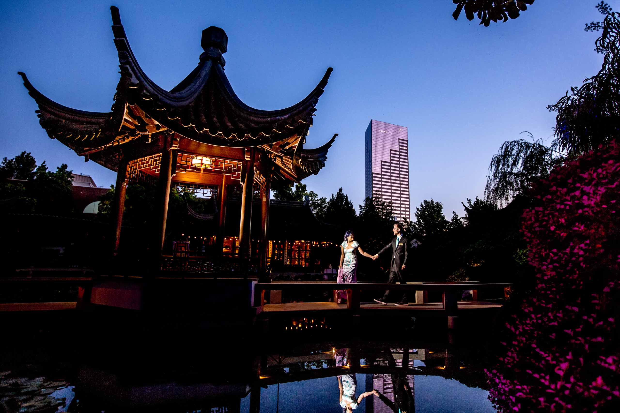 Bride and groom walking through the gardens for their Portland Chinese Gardens elopement