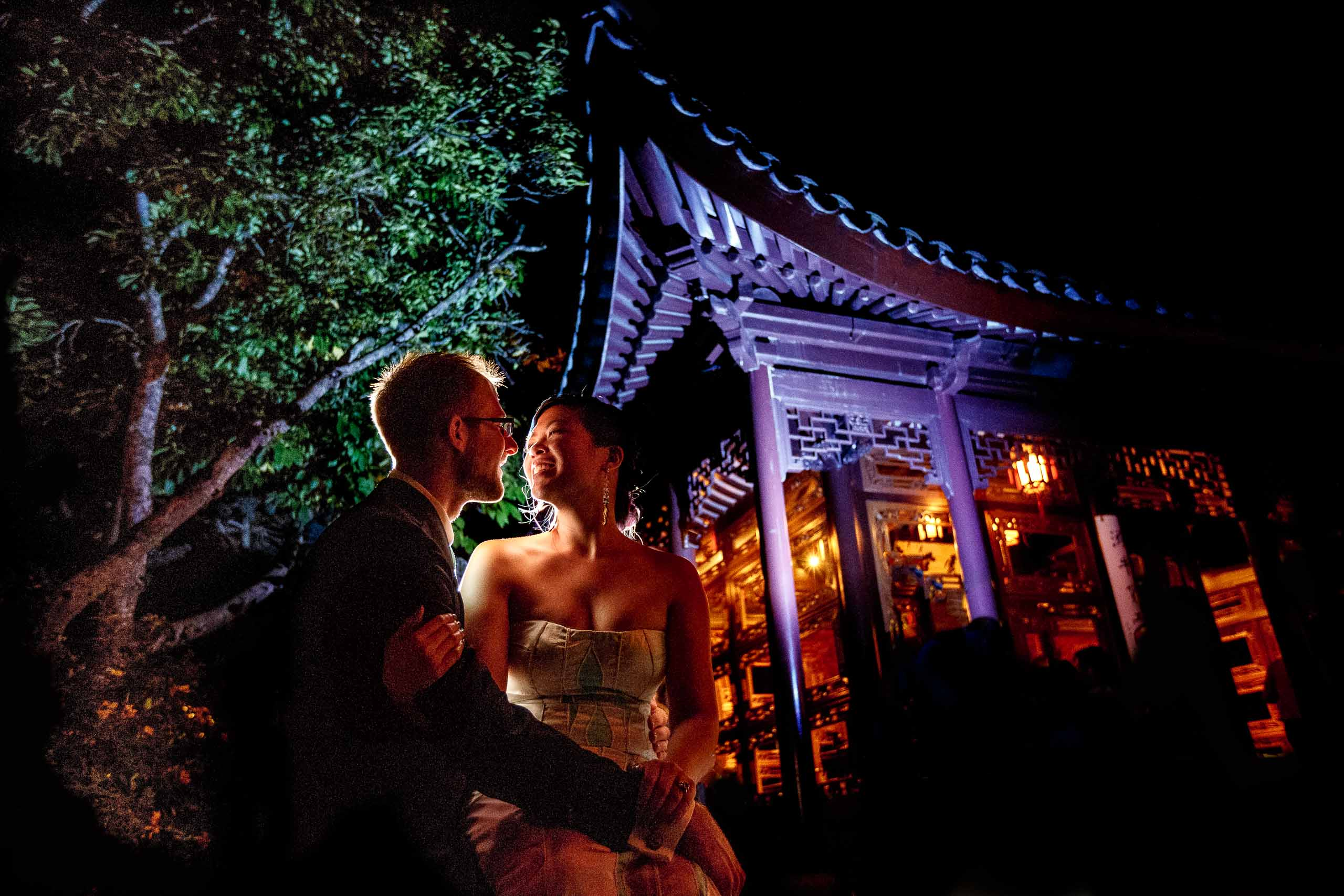 Bride and groom creative night portrait in the gardens for their Portland Chinese gardens elopement
